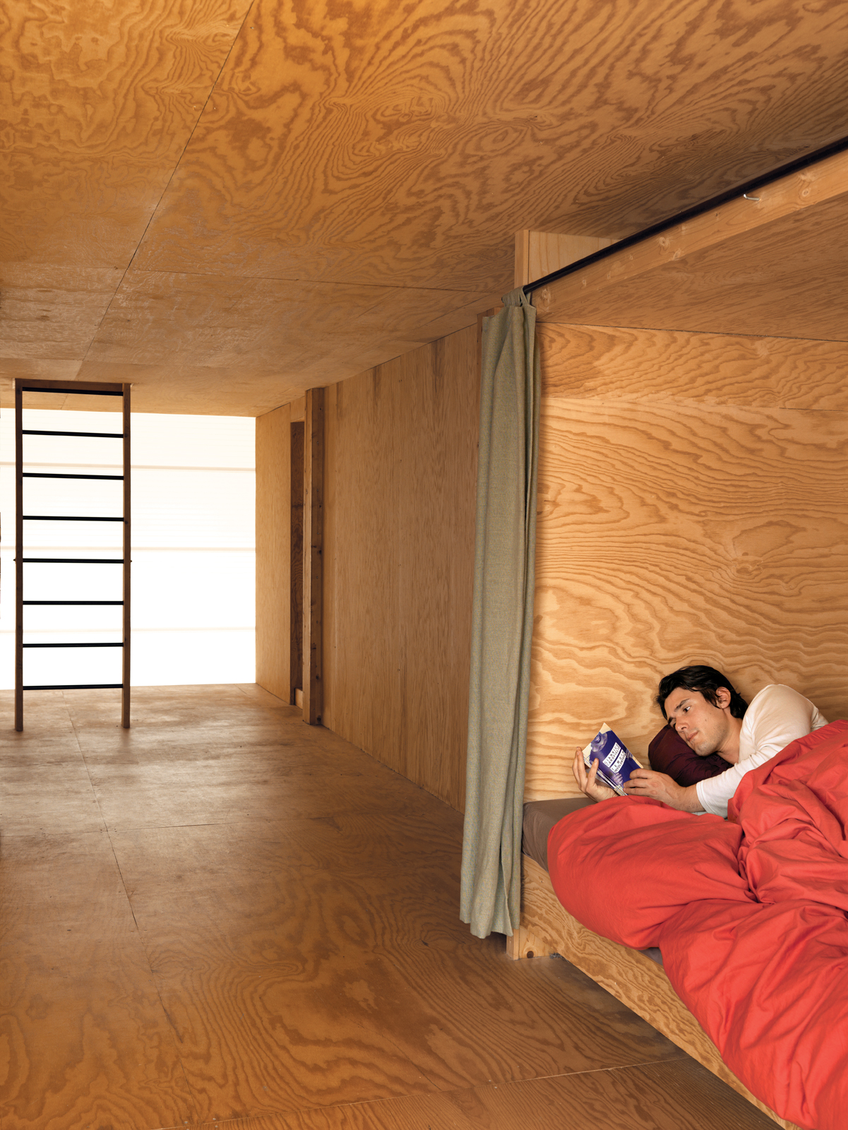 The second floor houses three lits bretons, boxlike compartments where the curtains can be drawn to close sleepers off from the world. Inside, each has a built-in shelf  for personal belongings and a favorite read.