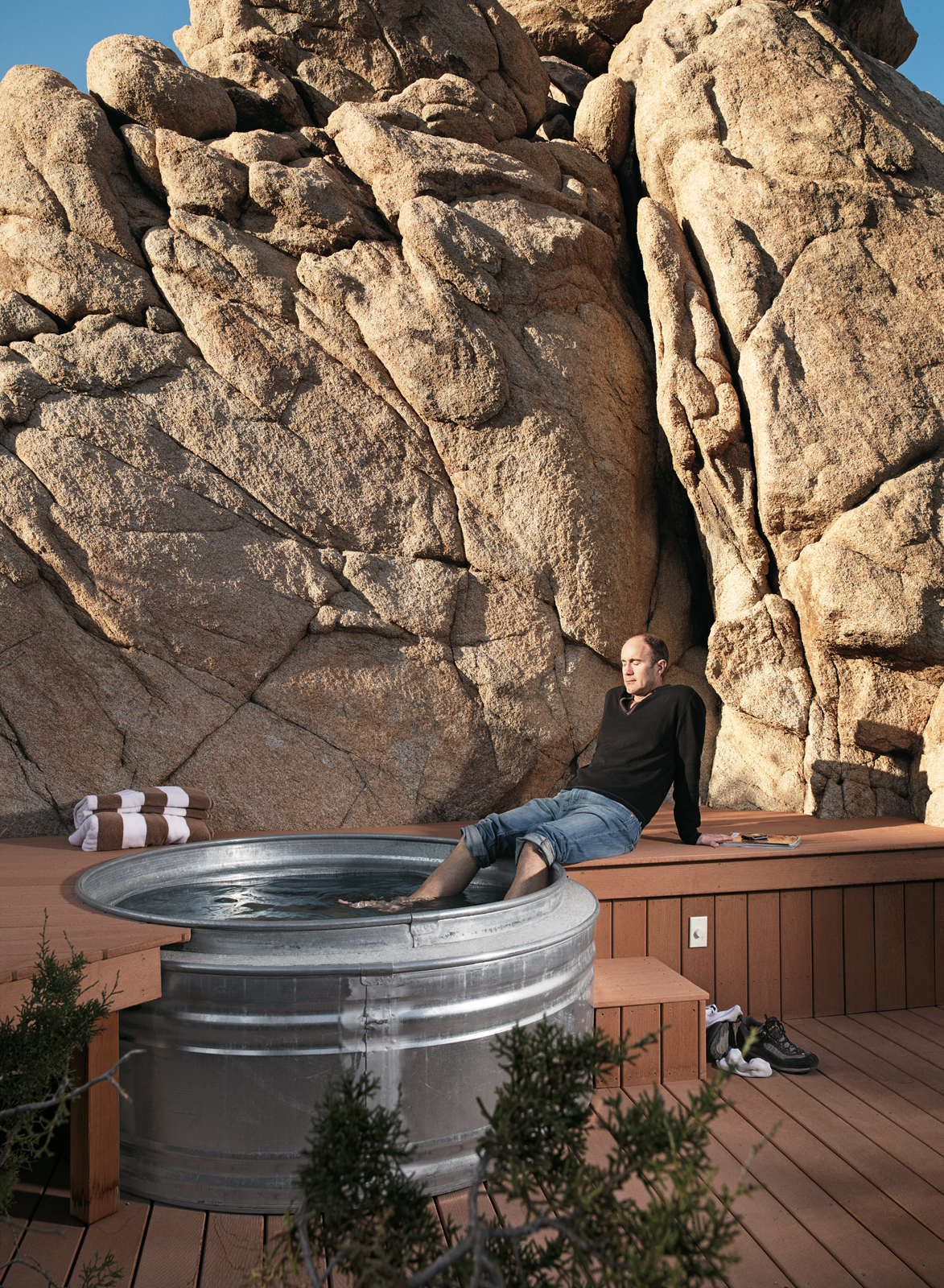 "Nighttime hikes often end at the the ""cowboy"" hot tub where Smith soaks his feet: two nested Hastings galvanized livestock feeders. The tub is surrounded by a Veranda faux-wood deck and fed with hot water from the house's solar hot-water system."