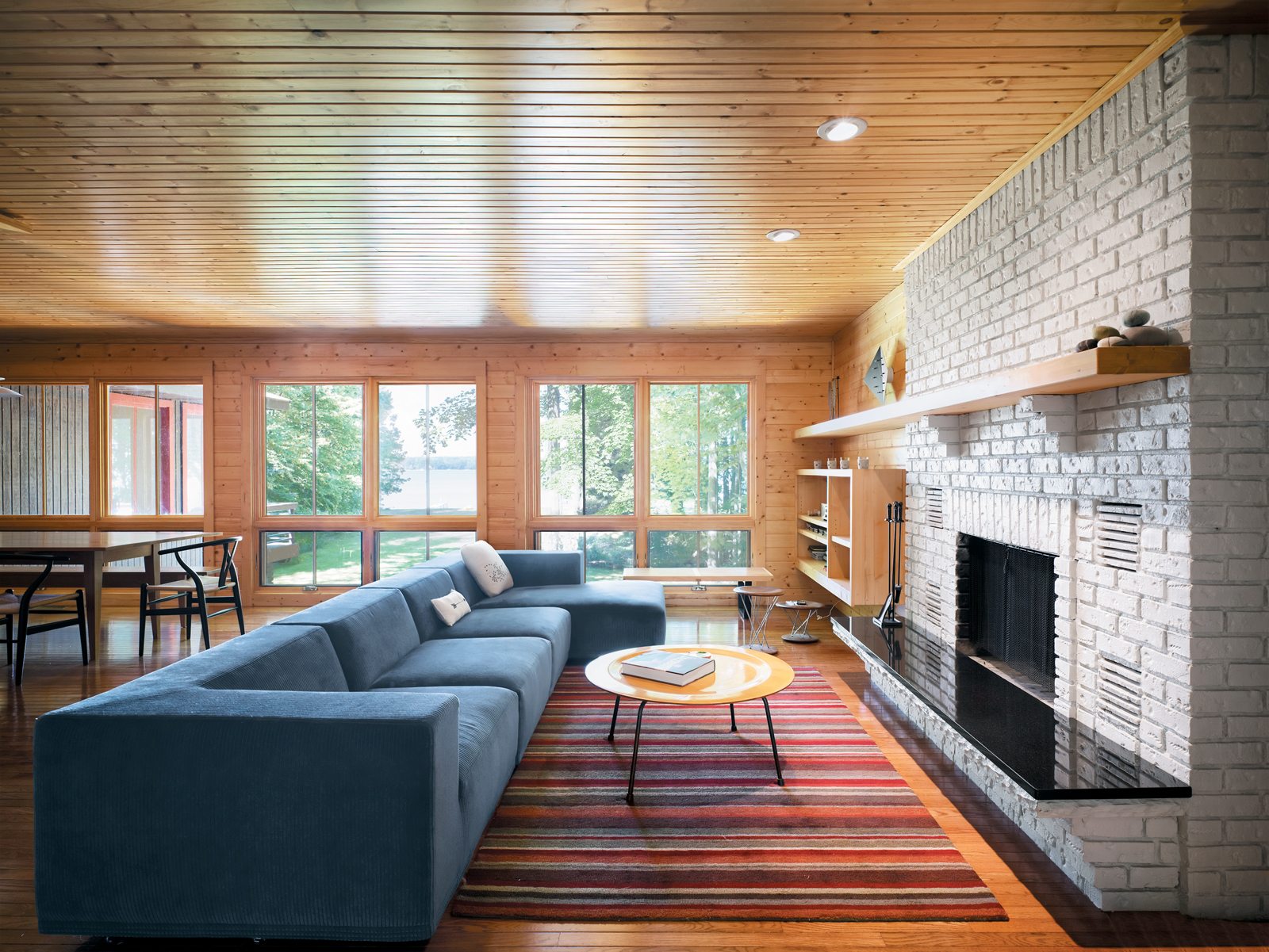 George Nelson and Eames furnishings from Michigan companies like Herman Miller blend seamlessly with original decor from Keith Campbell's childhood home in Ann Arbor. Seen here is the combined living and dining area.