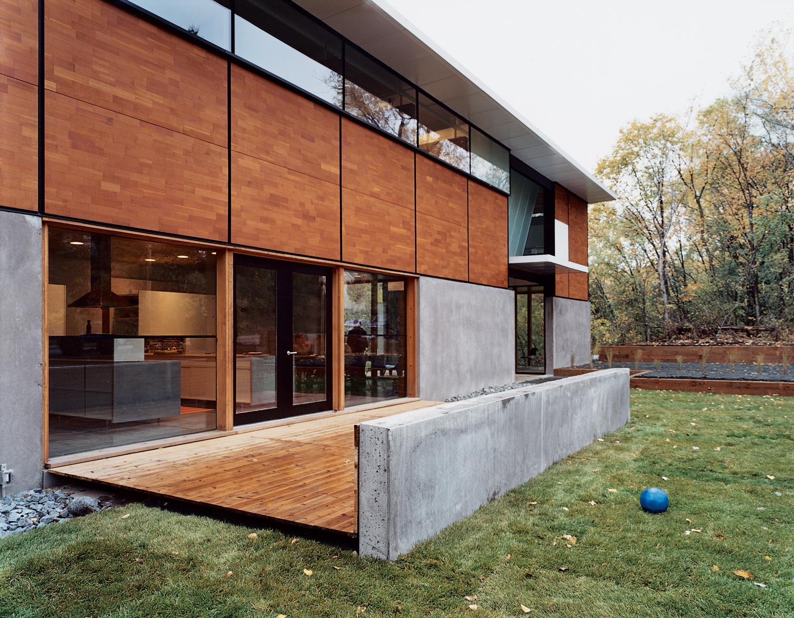 """Front view of the FlatPak House in Minneapolis, Minnesota. When the architect first told his wife about his idea, she said, """"It's about time you focus on a house for me!"""" He continues, """"It's like the old story about the cobbler whose kids have no shoes."""""""
