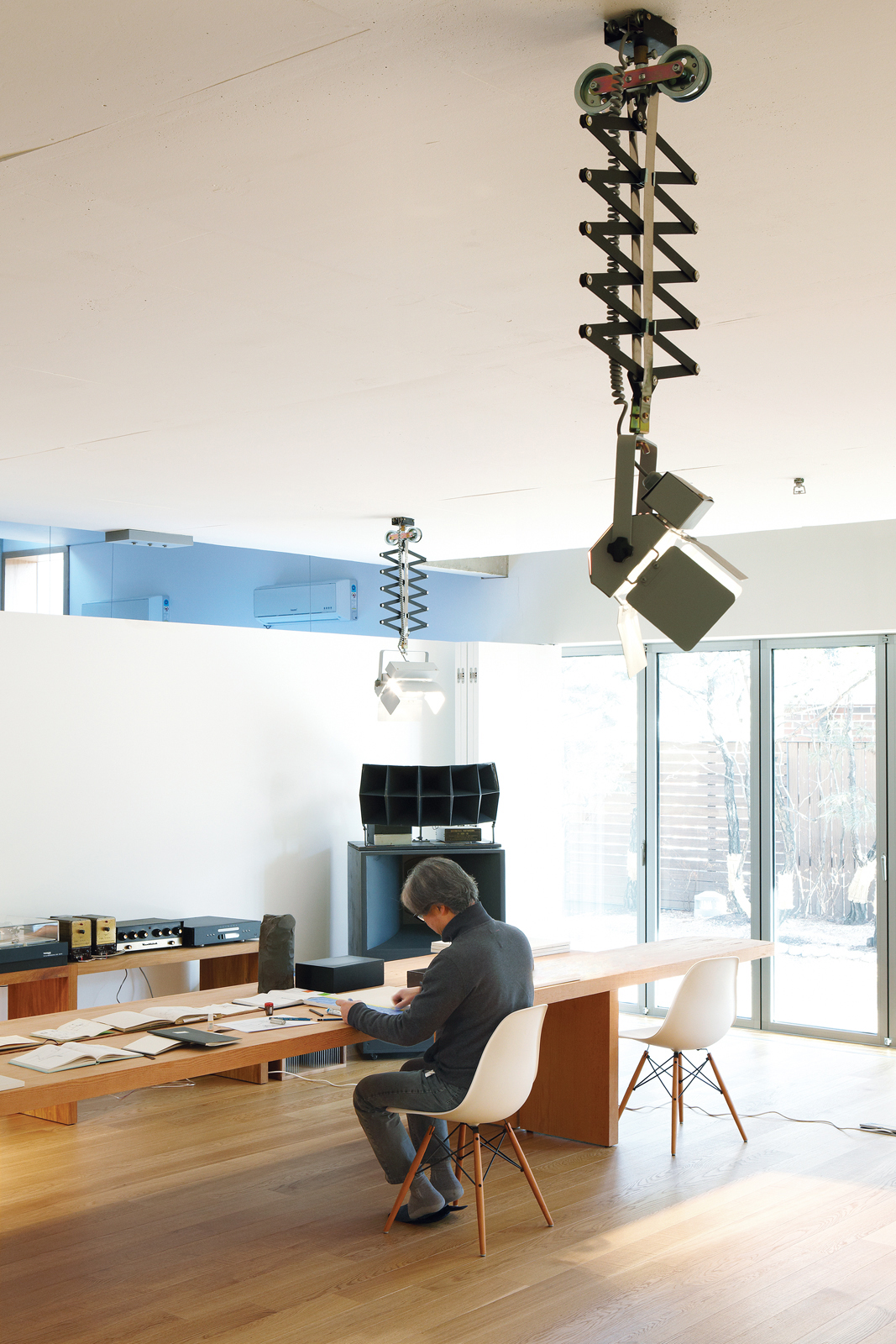 Light is a key element of the home's design. Photography lights from a local manufacturer keep the basement studio bright.