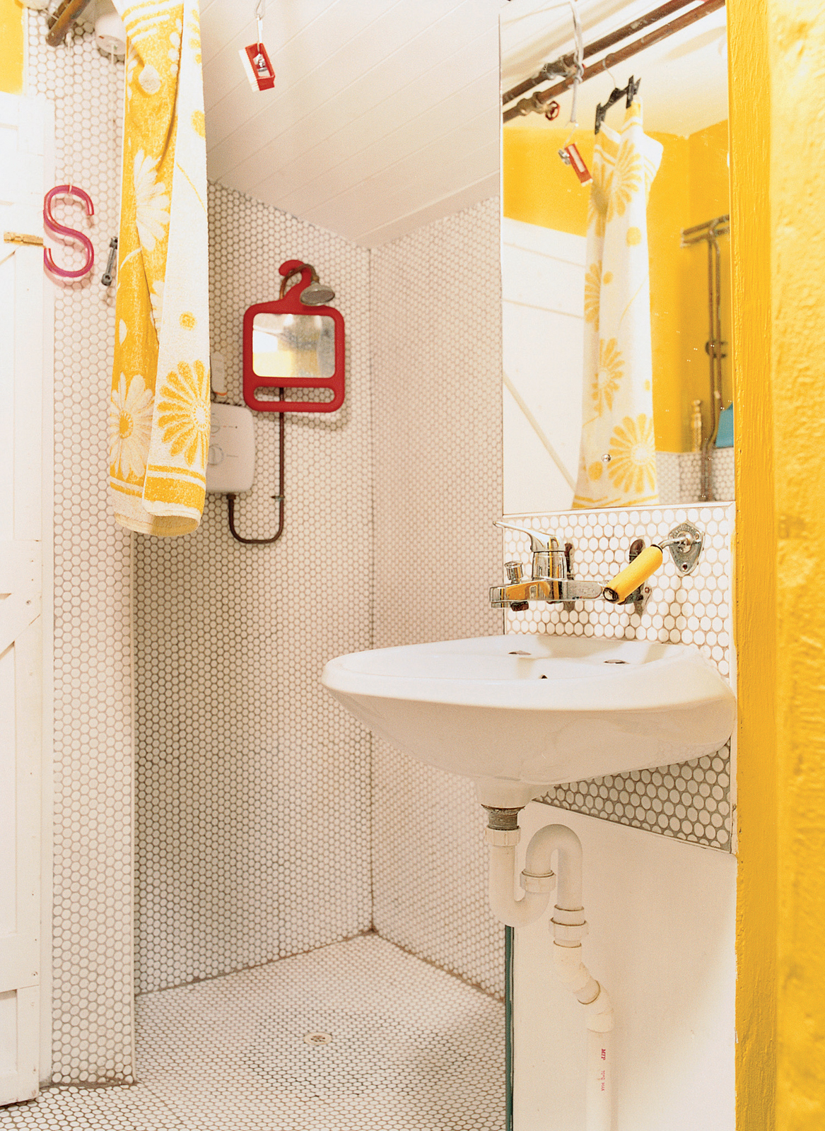 Hexagonal tile covers the wall and floor in the bathroom.