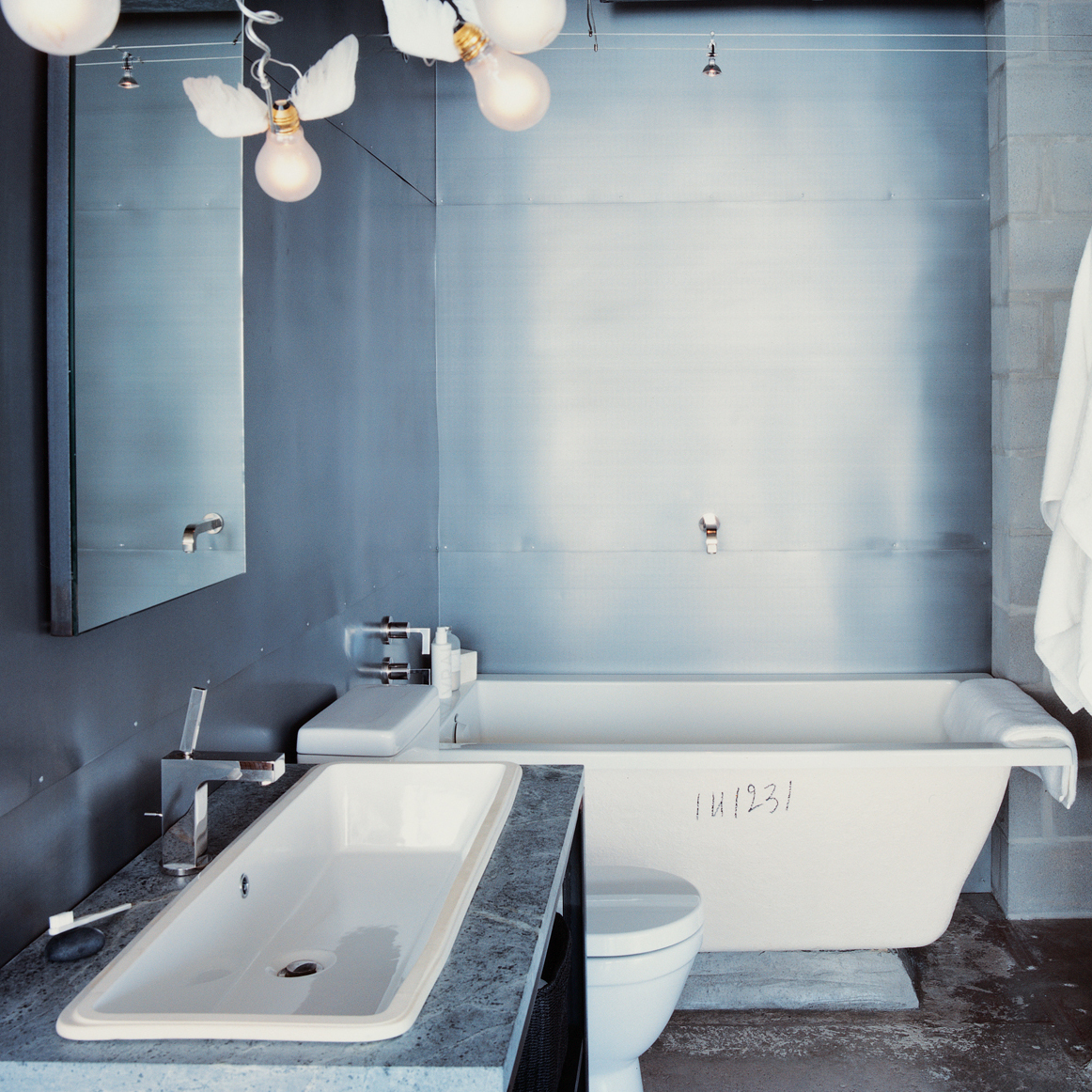 Hill house industrial bathroom in Houston