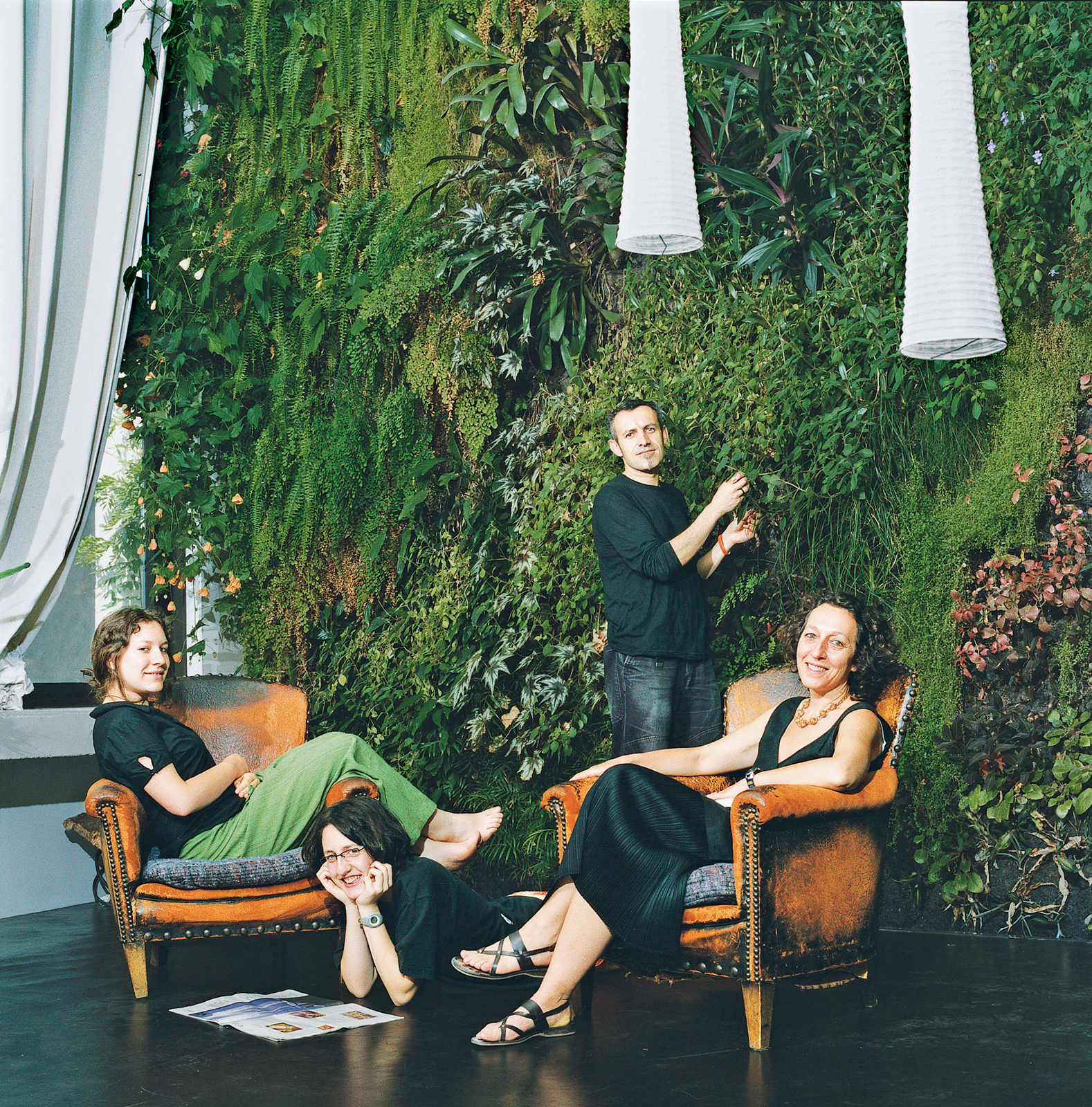 The Dimanches relax in their exotic living room.