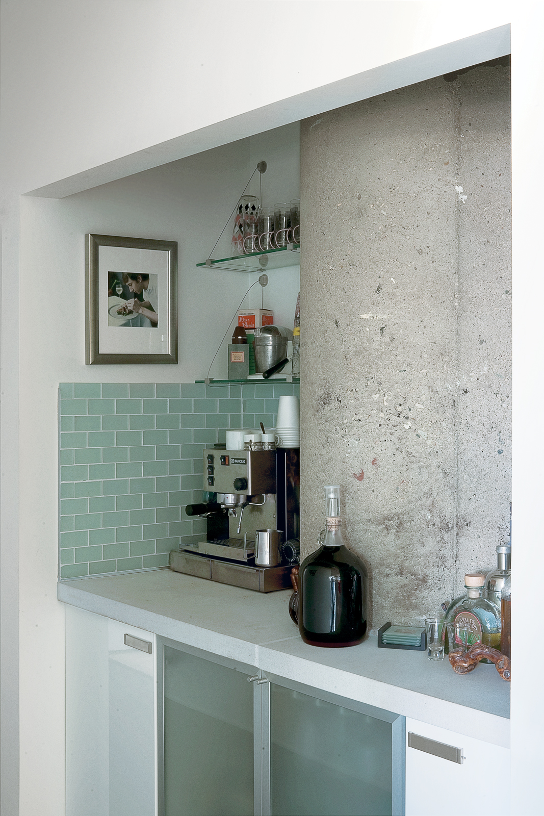 Arthur carved the Indiana limestone–clad bar out of an awkward space in the hallway.