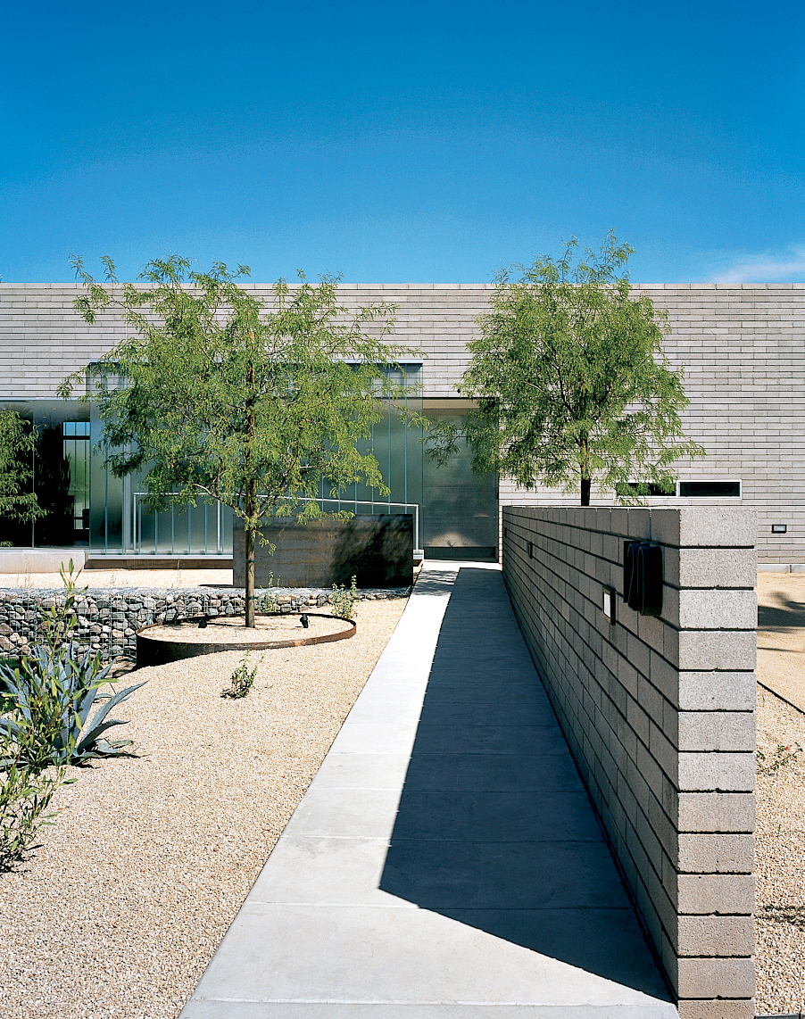 The DeBartolos wanted to keep the desert tradition of incorporating water near the entrance of the house as a sort of welcome mat, but they skipped the faux hacienda fountain found throughout Arizona in favor of twin sheets of four-by-eight-foot steel pla