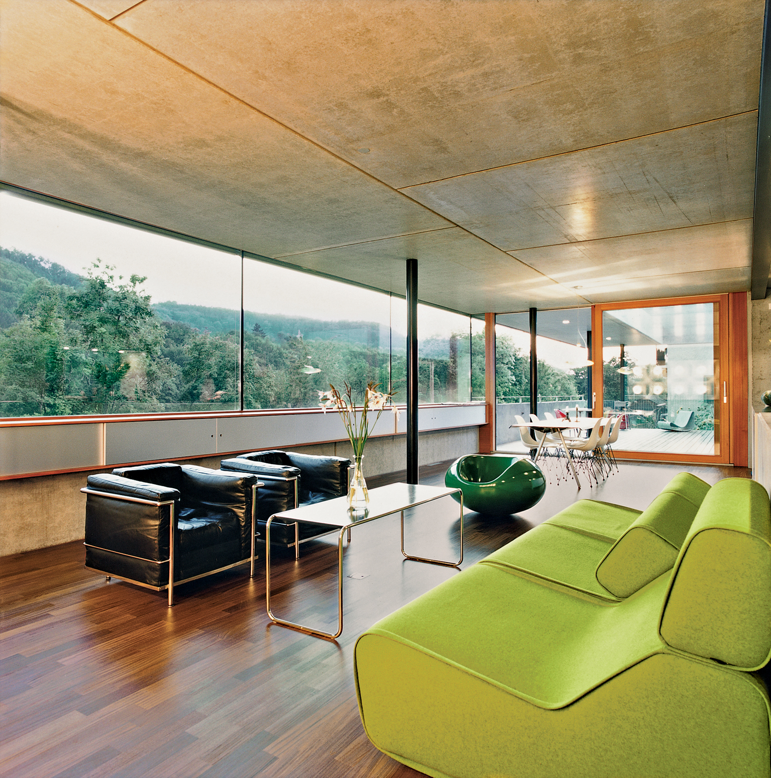 After walking through the front door visitors enter directly into the enormous kitchen and living space. The interior is minimal, using predominantly timber and concrete. It also provides some spectacular views of the river.