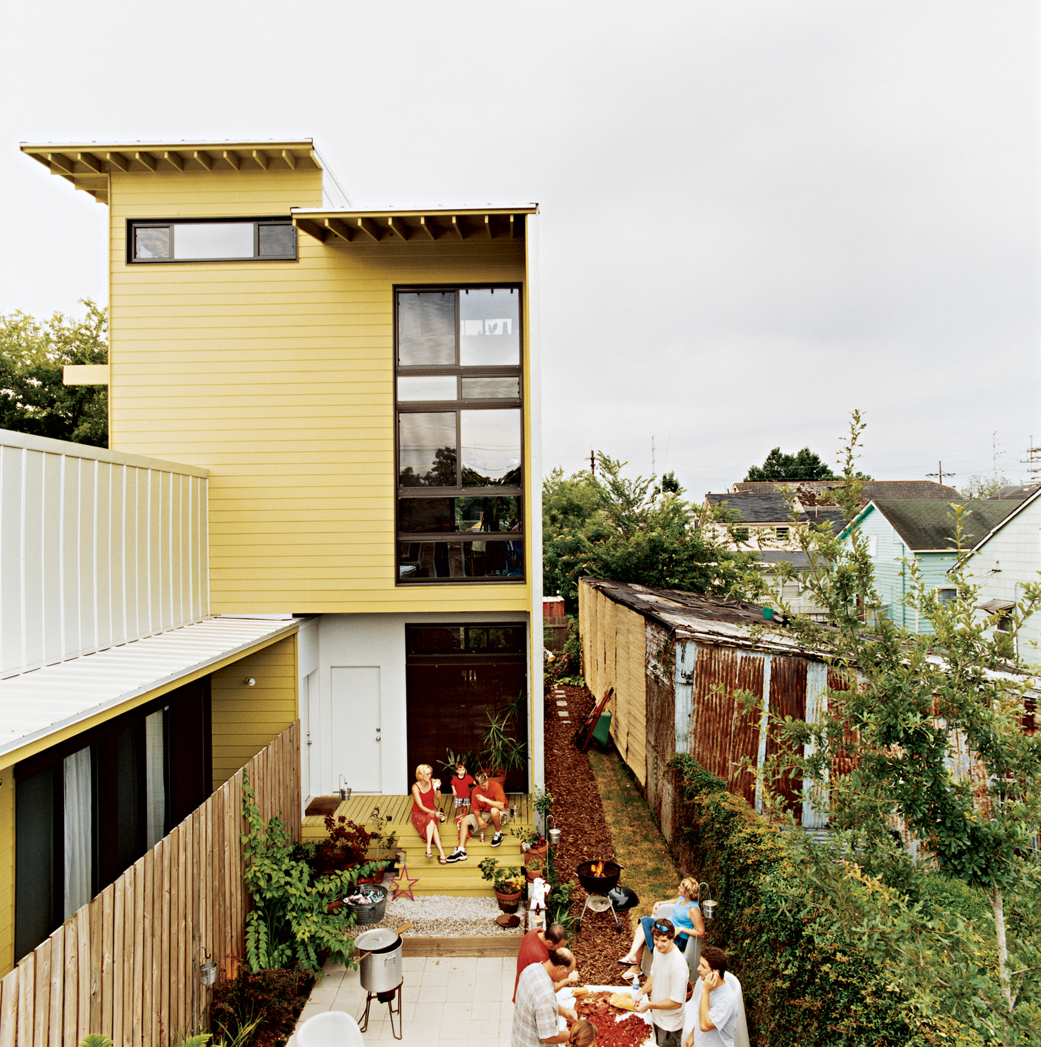Familiar building elements applied in unexpected ways and a strict rectilinear palette help unify the two building forms. The scale is just right for creating cozy outdoor rooms.