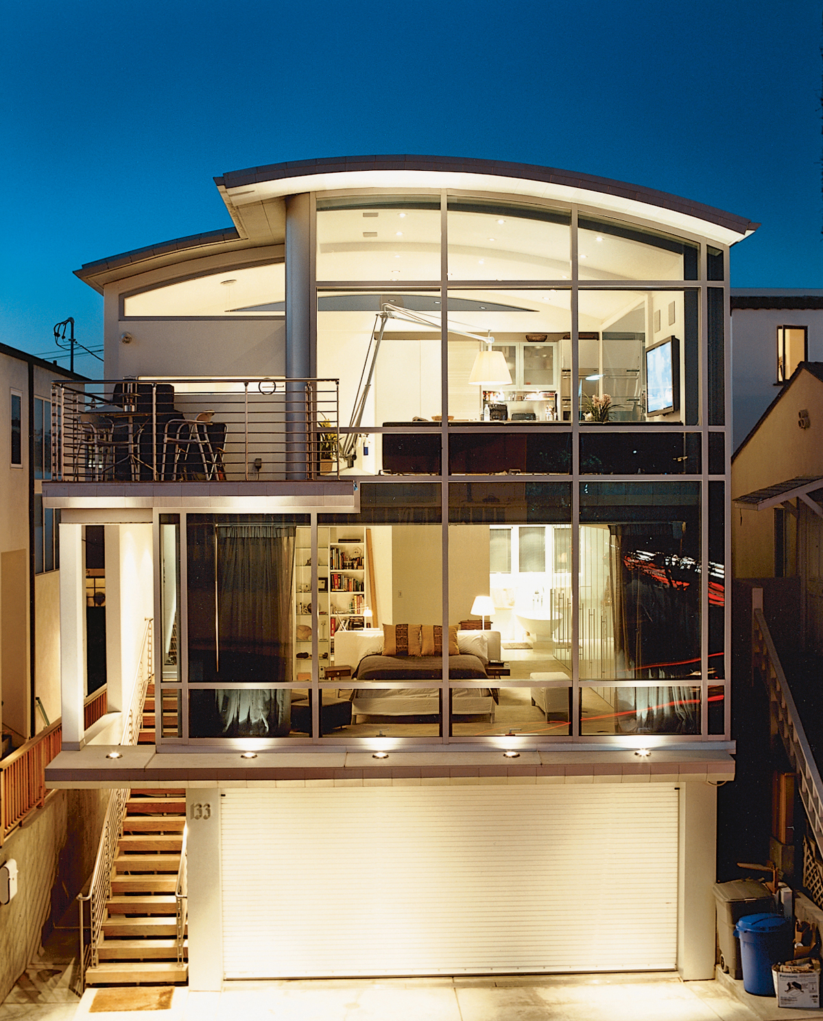 """It didn't bother me to do a house with a lot of things half the size of what people think is normal,"" John Picard says of his half-lot home in Manhattan Beach. The home's steel frame offers a maximum expanse of glass. Because of the small footprint, Pica"