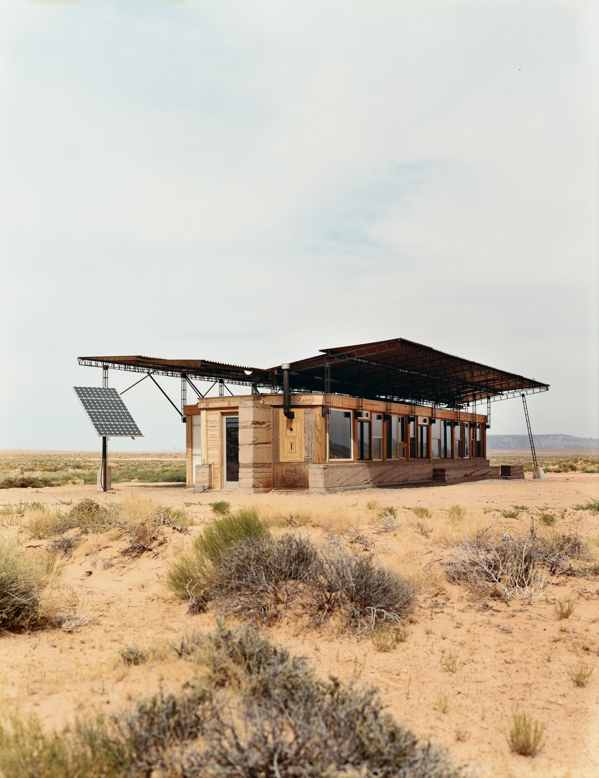 Entirely off the grid, the house is powered by four photovoltaic panels that supply electricity to lights, small appliances, and water pumps.