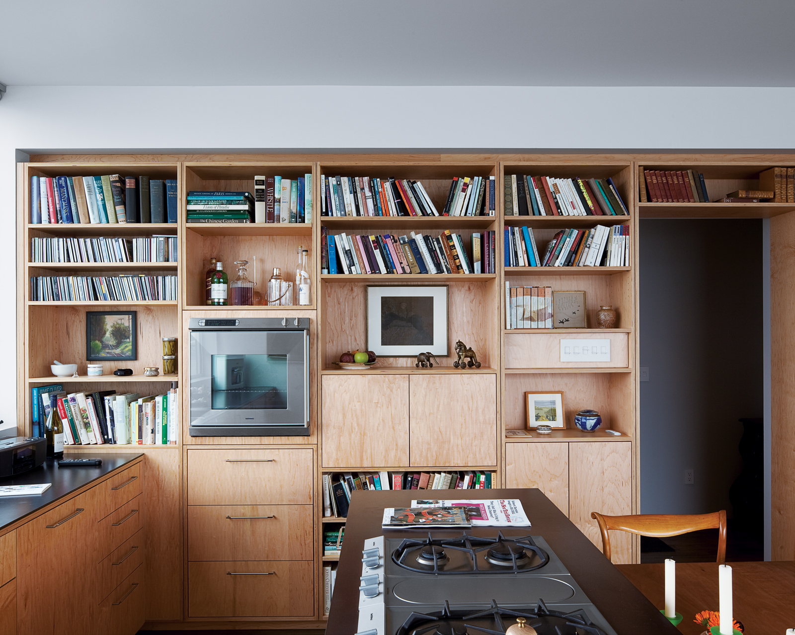His Gaggenau oven and range, set into an oiled-steel counter, help heat things up in his kitchen.
