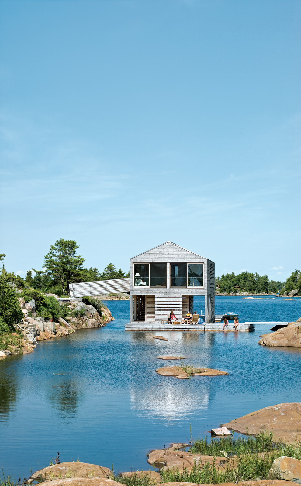 Cedar slats mark the facade of Floating House, Doug and Becca Worple's lake house in Ontario.
