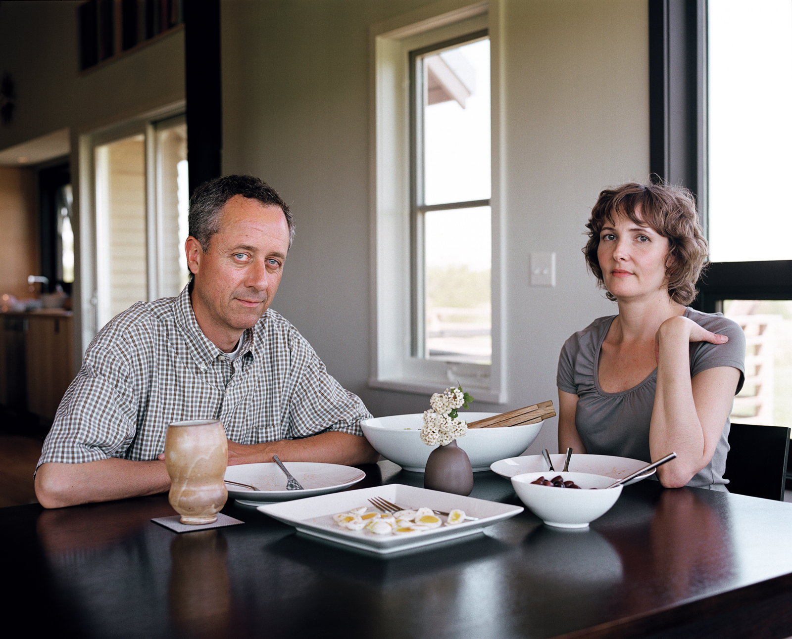 At their dining table, the Moumings enjoy the fruits of Joanna's passion for cooking and Geoff's passion for growing.