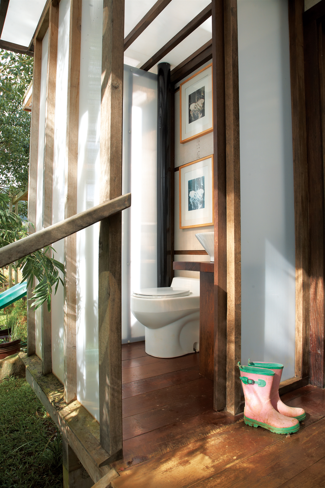 Bathroom with composting toilet and found wood table