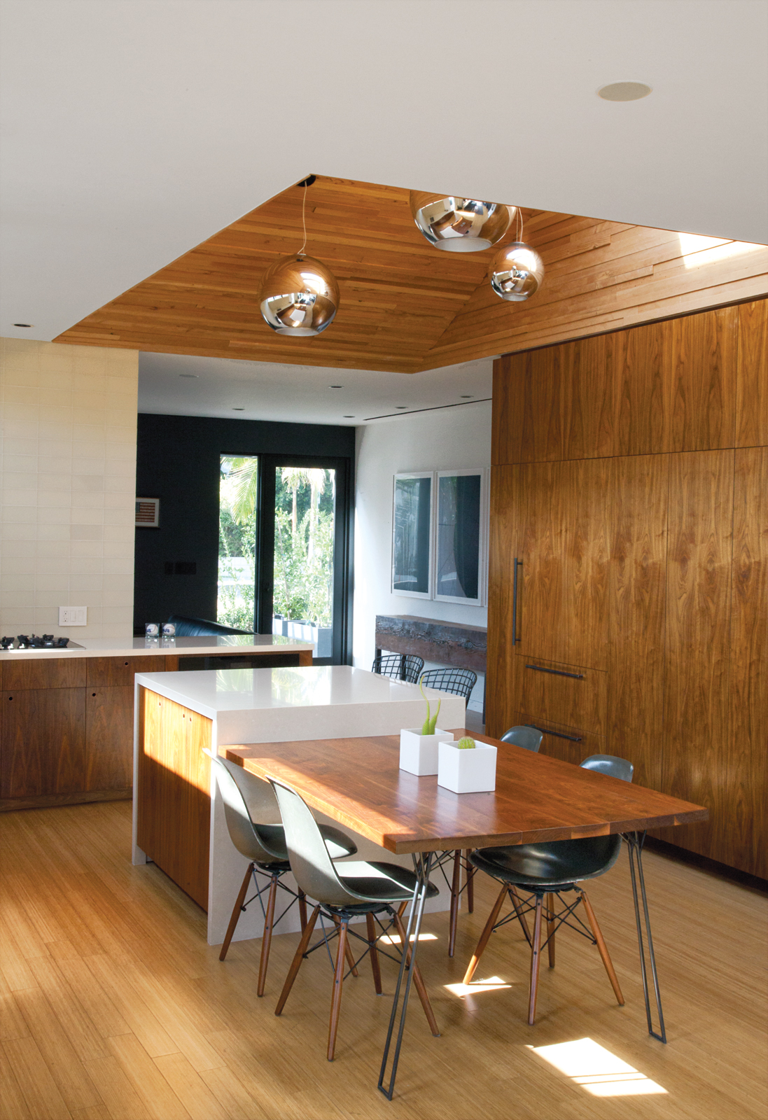 Custom walnut dining furniture in modern kitchen