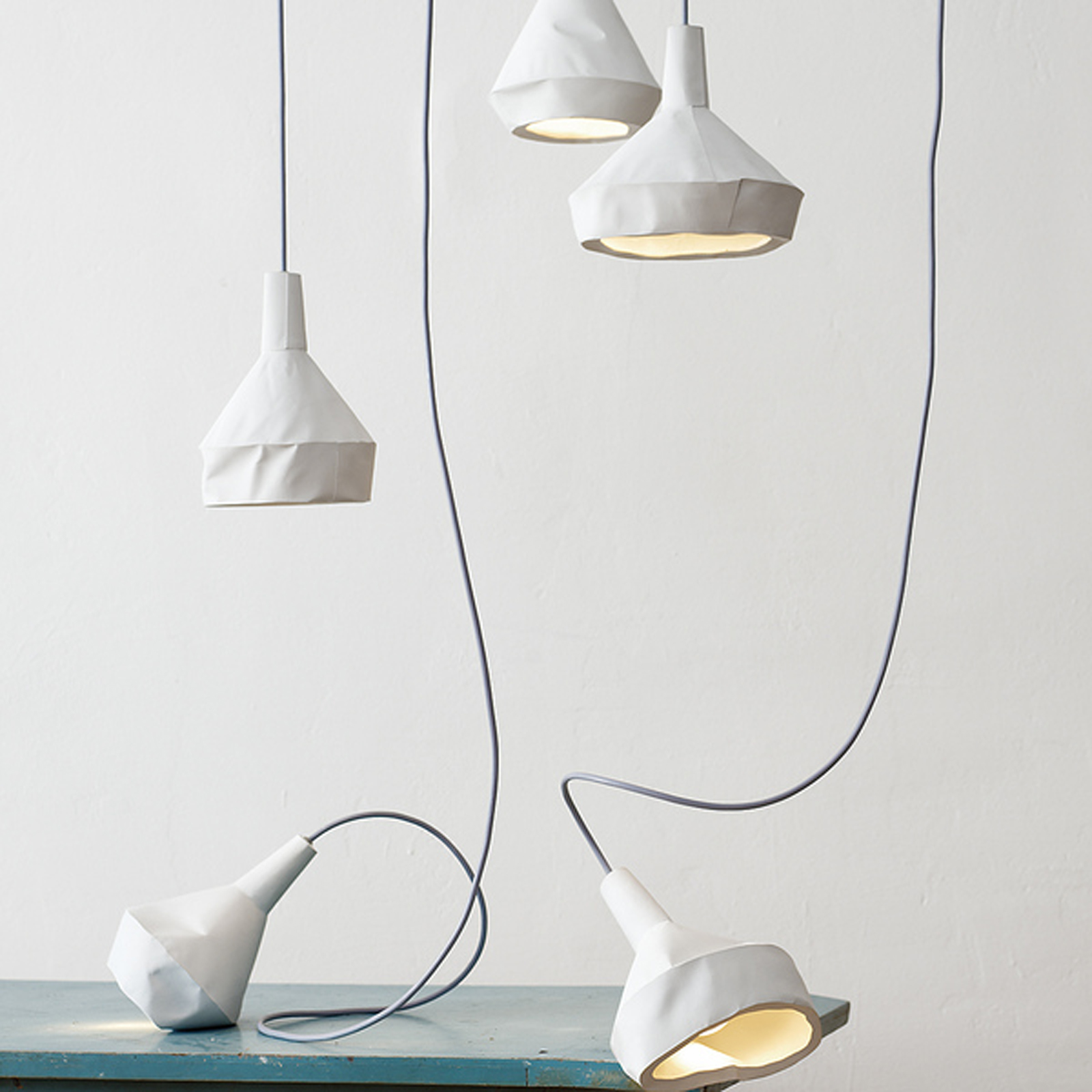 """Thought these lamps by <a href=""""http://aust-amelung.com/"""">Miriam Aust and Sebastian Amelung</a> appear to be featherweight paper, they're actually concrete!"""