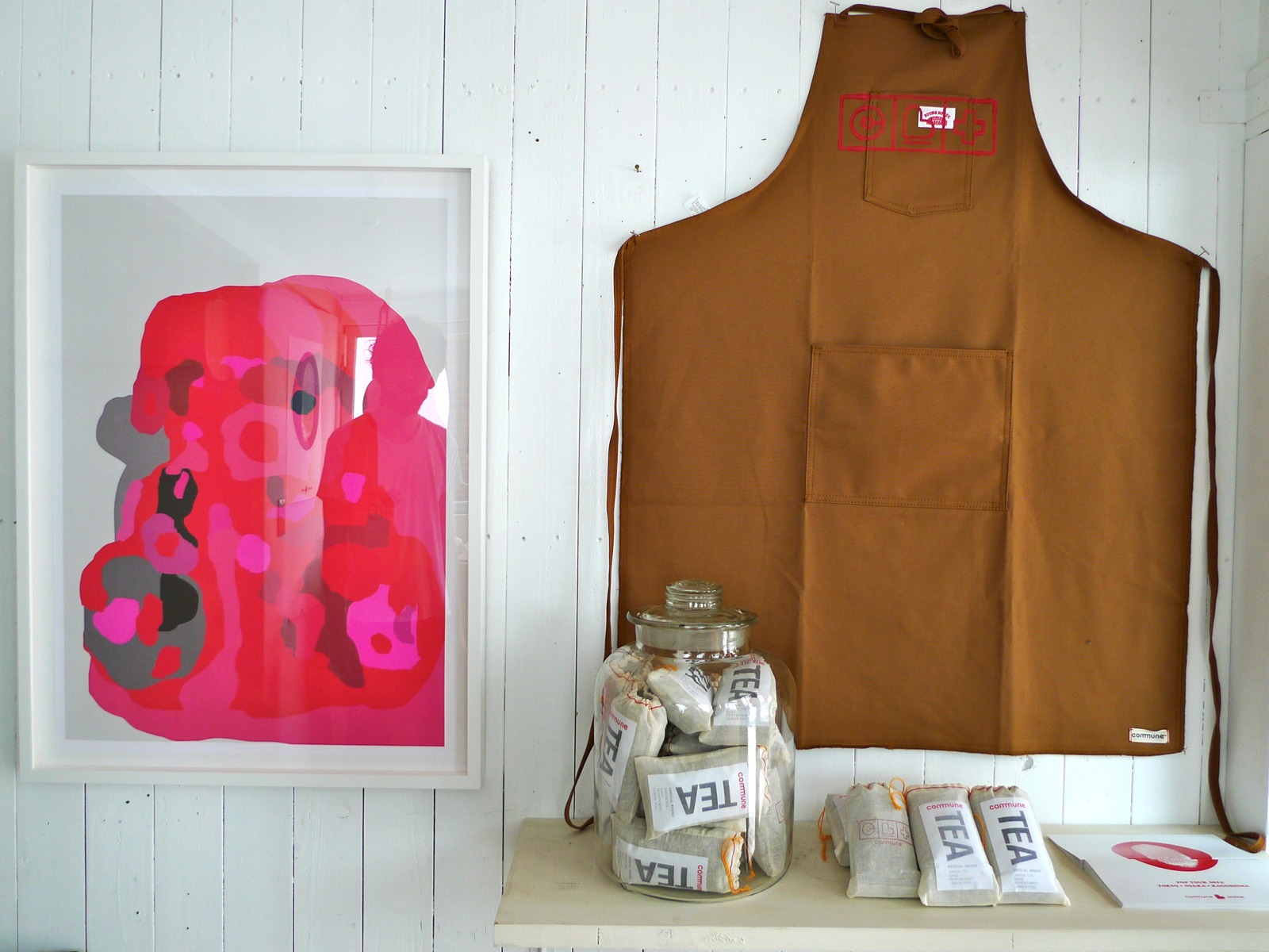 The apron and tea are sold by Commune to benefit tsunami victims.