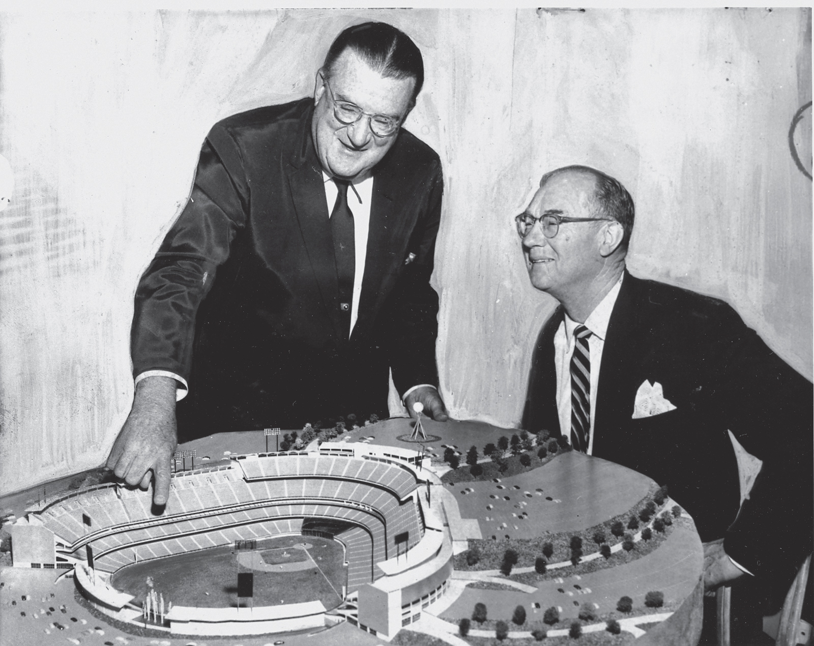 Walter O'Malley and Del Webb looking at a Dodgers Stadium model