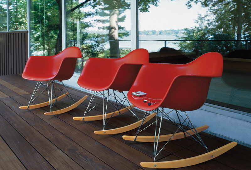 Trio of red Eames rocking shell chairs
