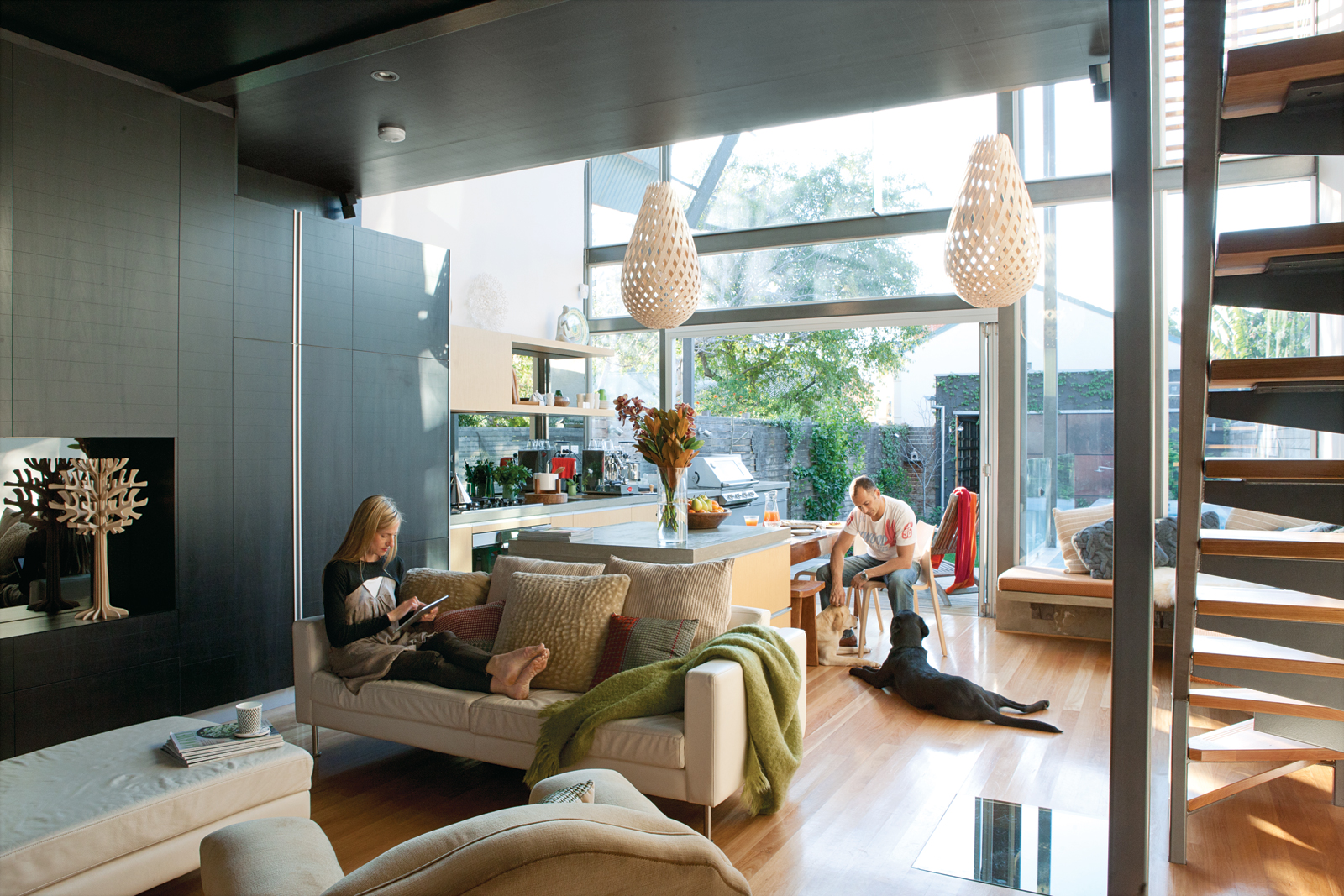 open dining and living room area with Koura pendant lamps