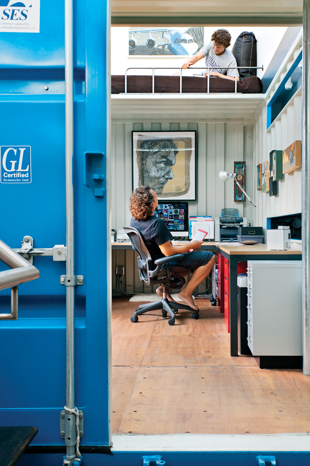 Shipping container home office with bunk bed