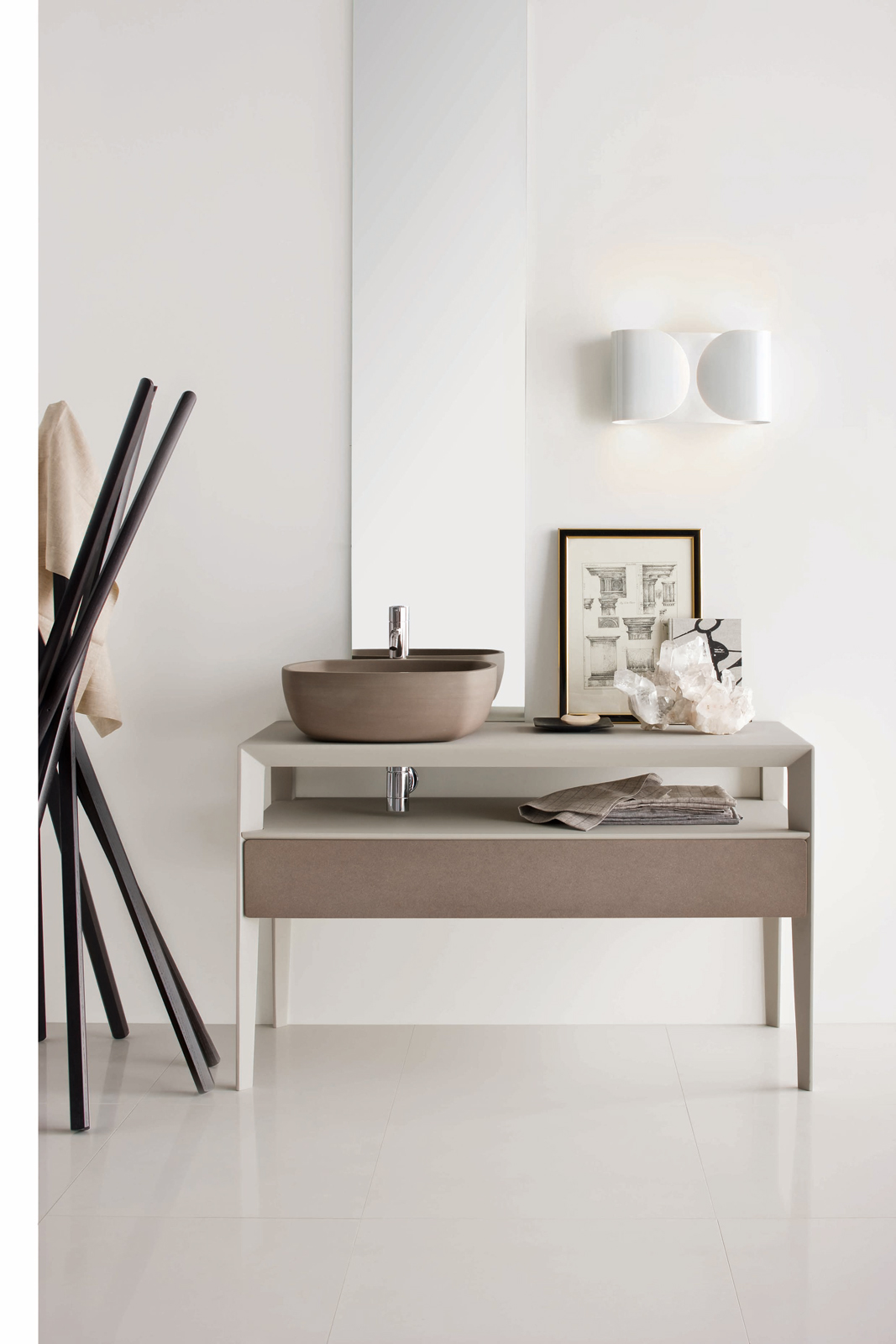 Inkstone wash-basin in Sand Brown stone with Neos furniture in an Ice silk finish, with Sand Brown stone fronts (Neos furniture designed by Luca Martorano).