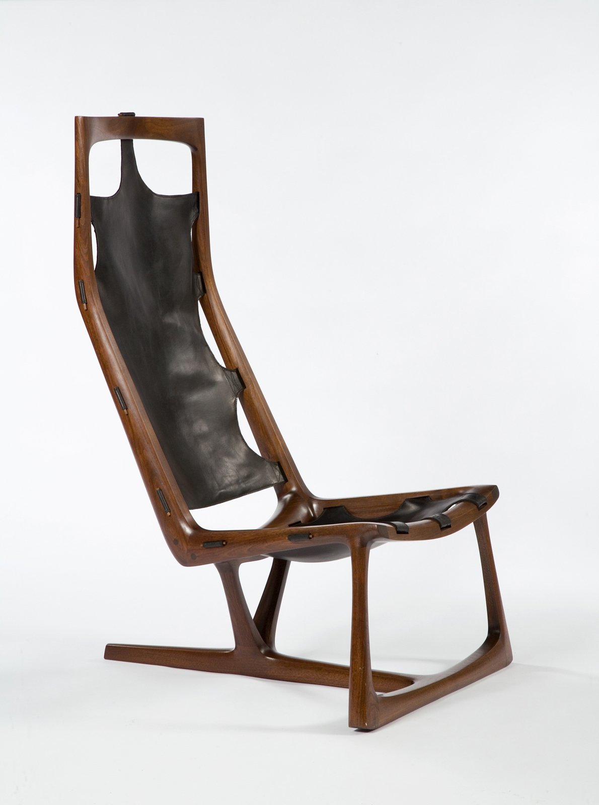 Modern wood lounge chair by Wendell Castle