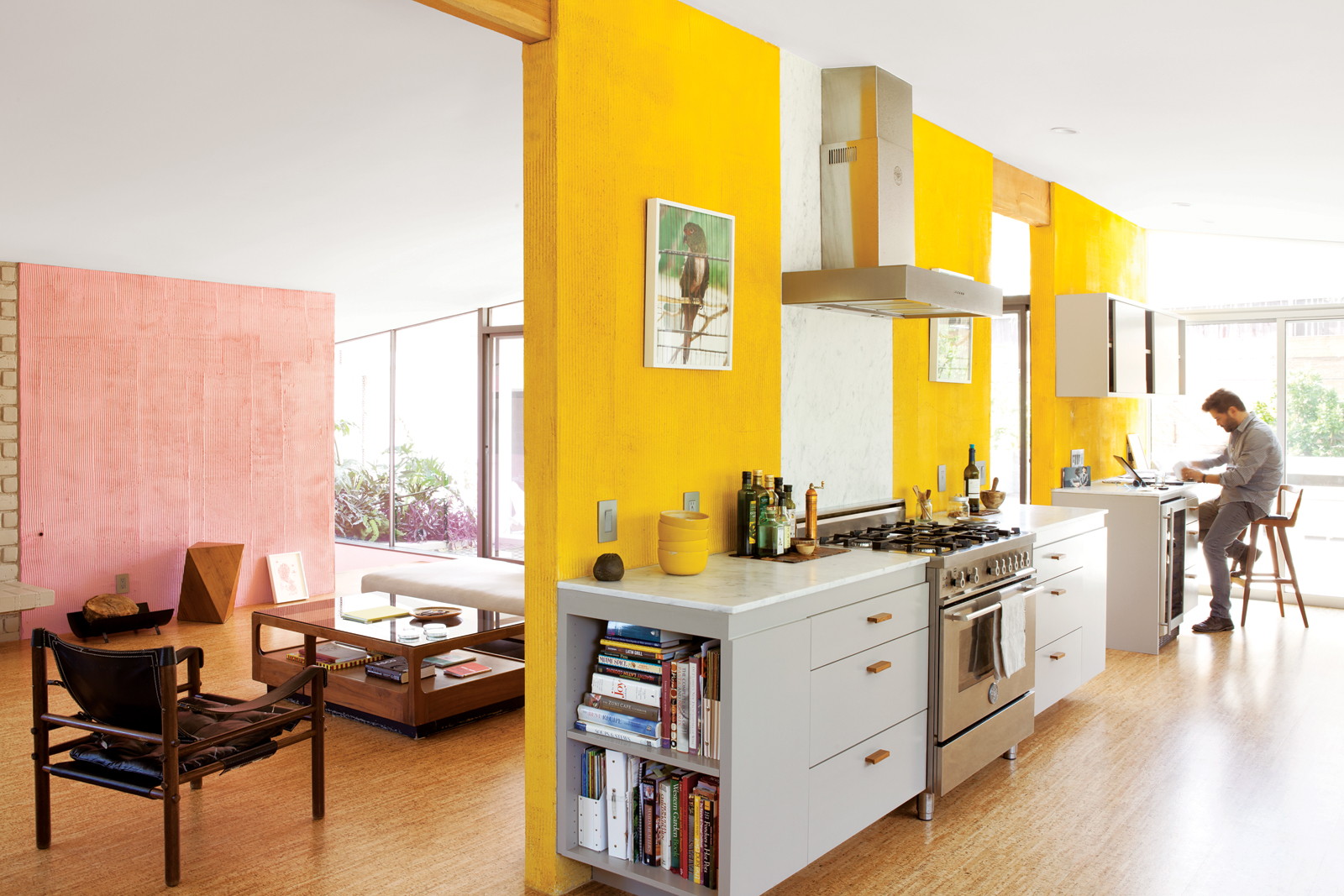 Modern kitchen with yellow sectioned walls and monochrome appliances