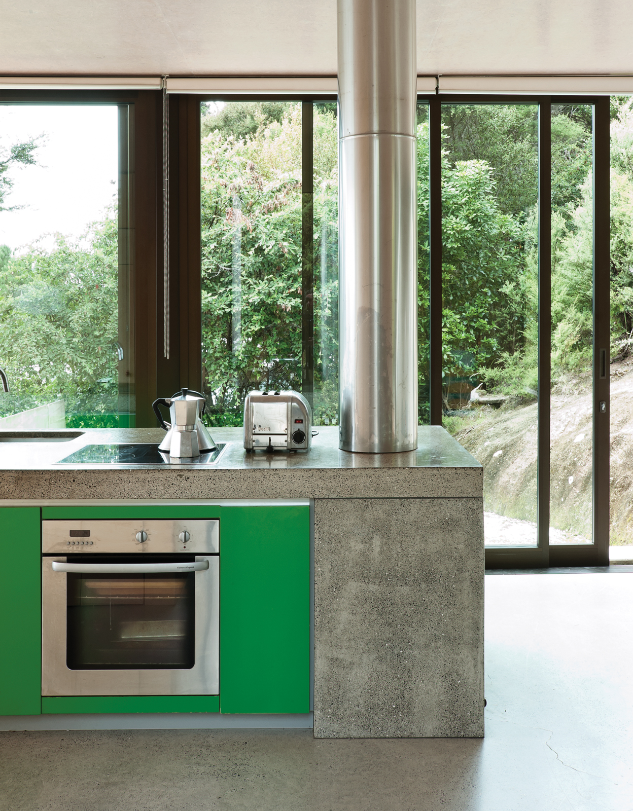Simple kitchen with sliding doors and concrete cabinets