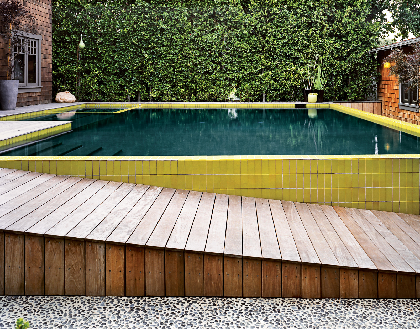 Tiled pool with descending wood plank