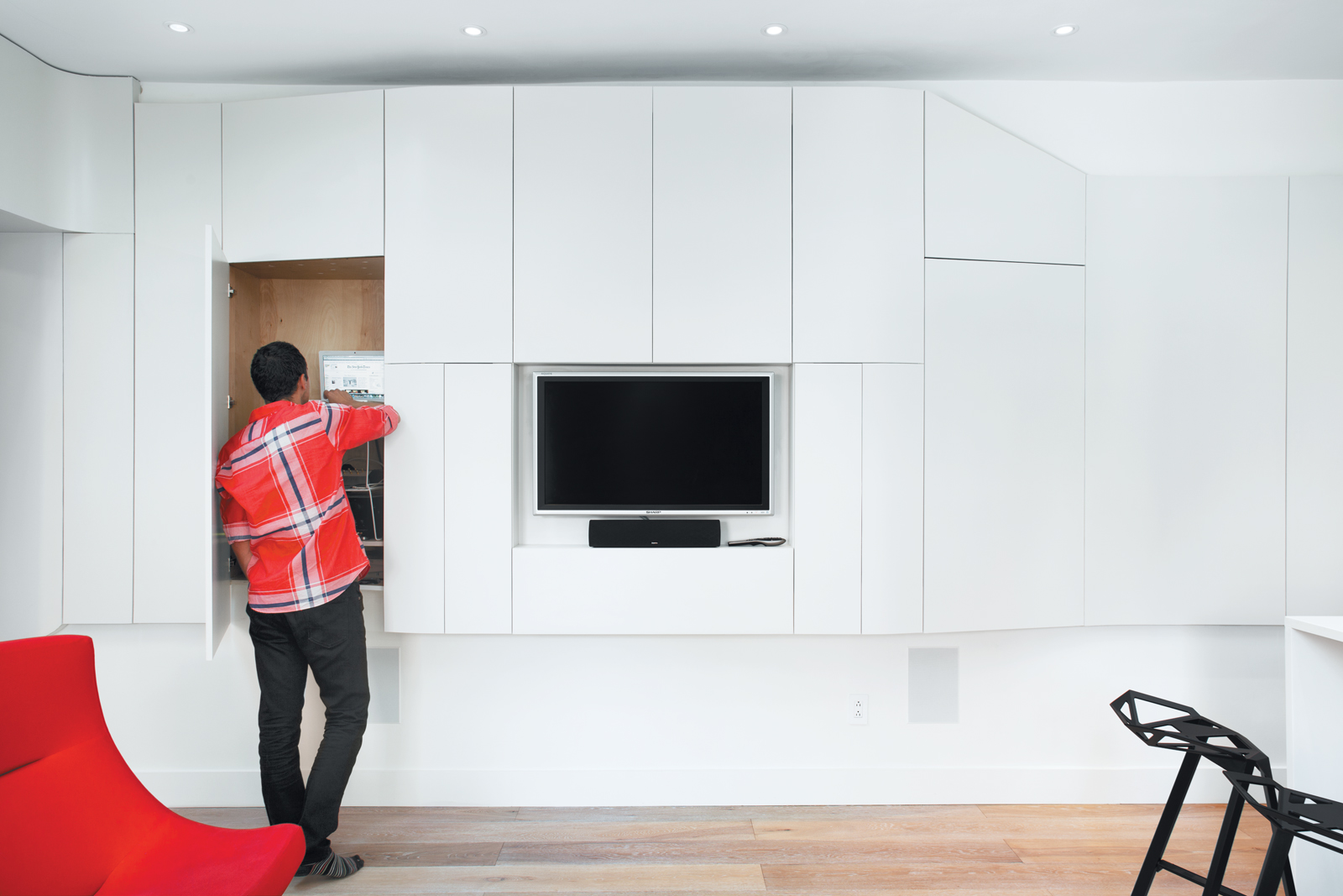 Media wall area with pop-out storage closets