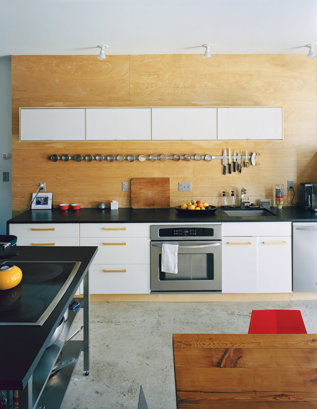 Modern Ikea-furnished kitchen with concrete floors