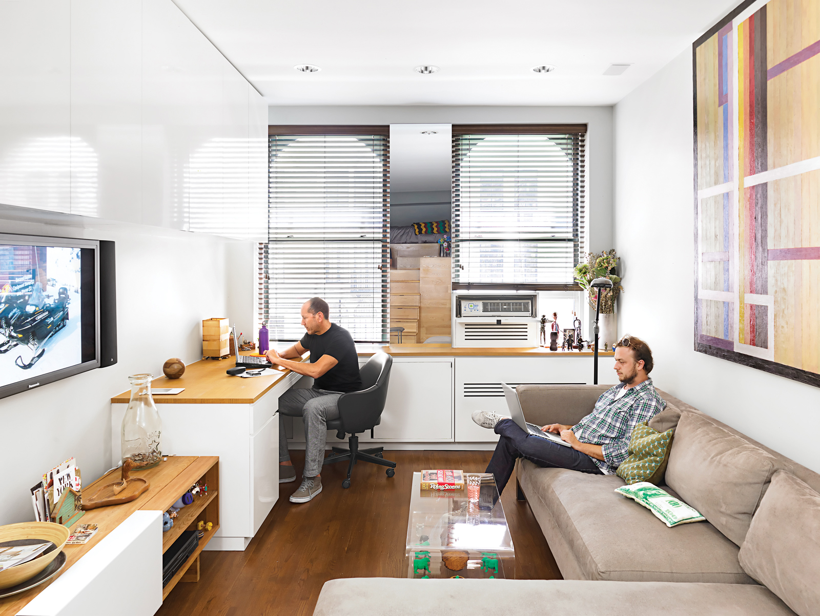 Living office room with oak paneling and wall-size custom cabinetry