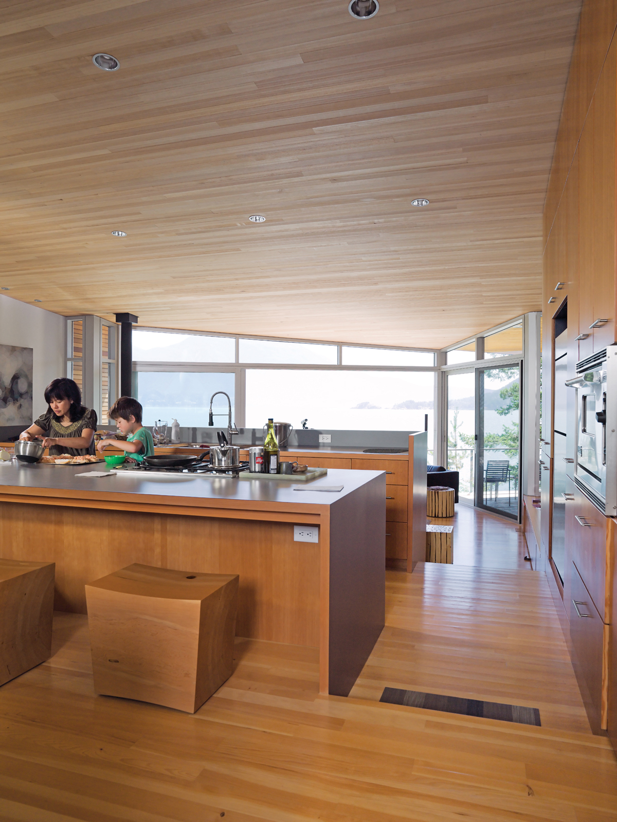 Open-plan kitchen with untreated hemlock ceiling