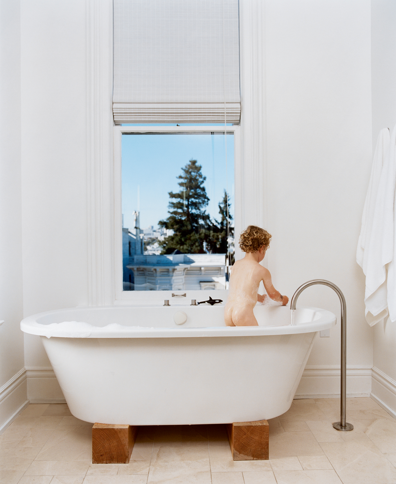 Jonathan Nelson's one wish for the master bathroom was for views from the Zuma tub. He got that and then some, and now three-year-old Jonas (pictured) and his older brother refuse to bathe anywhere else. The stand-alone faucet is by Lefroy Brooks from the