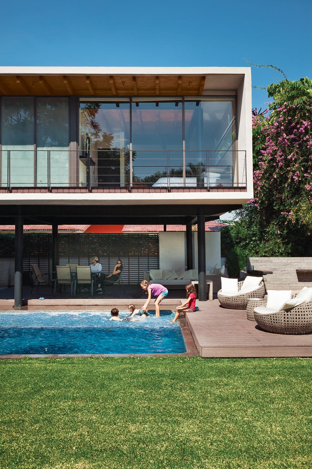 Modern backyard pool with Trex decking