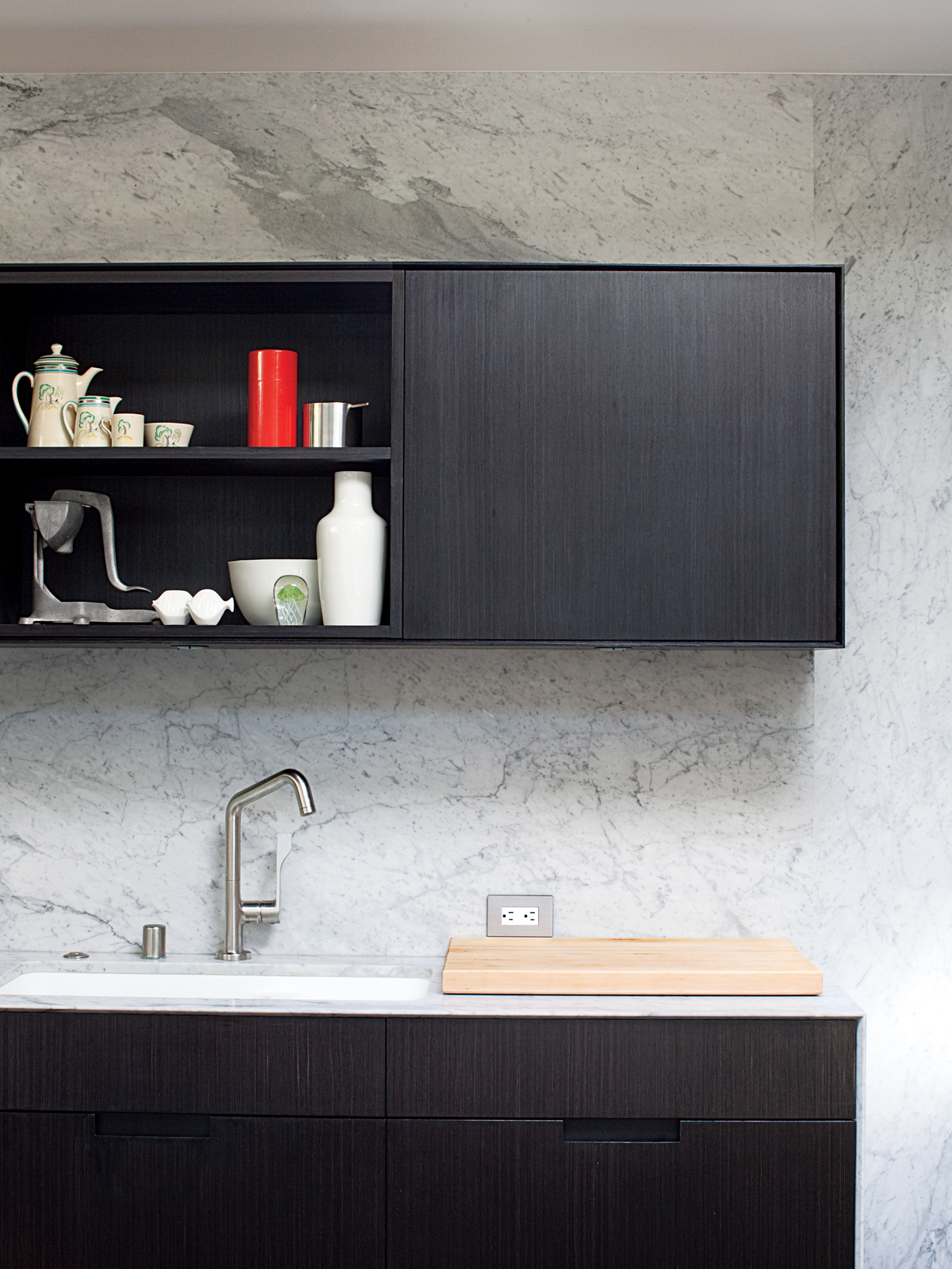 Stained black and painted white cabinets and countertop