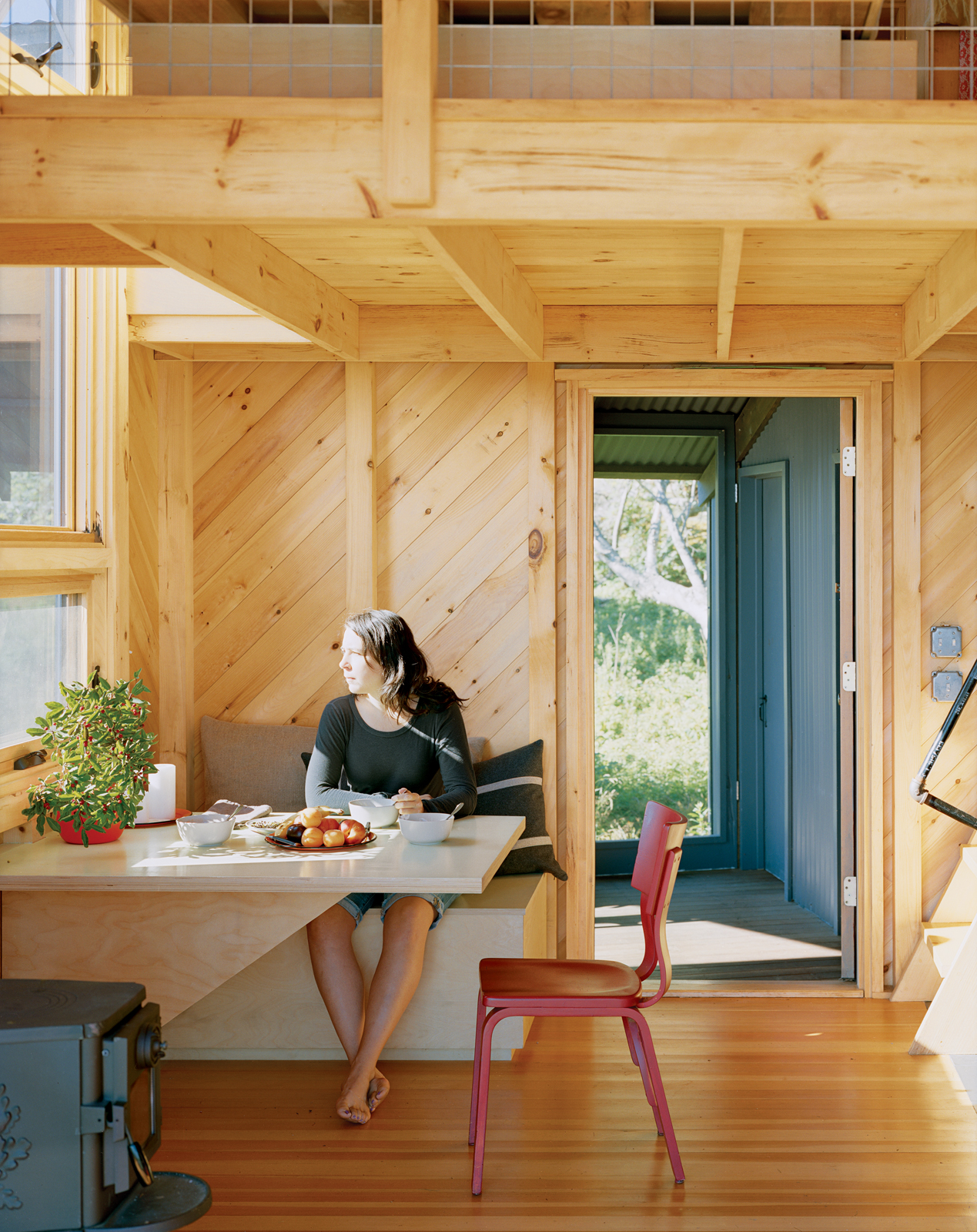 Pine clad dining room with built-in furniture