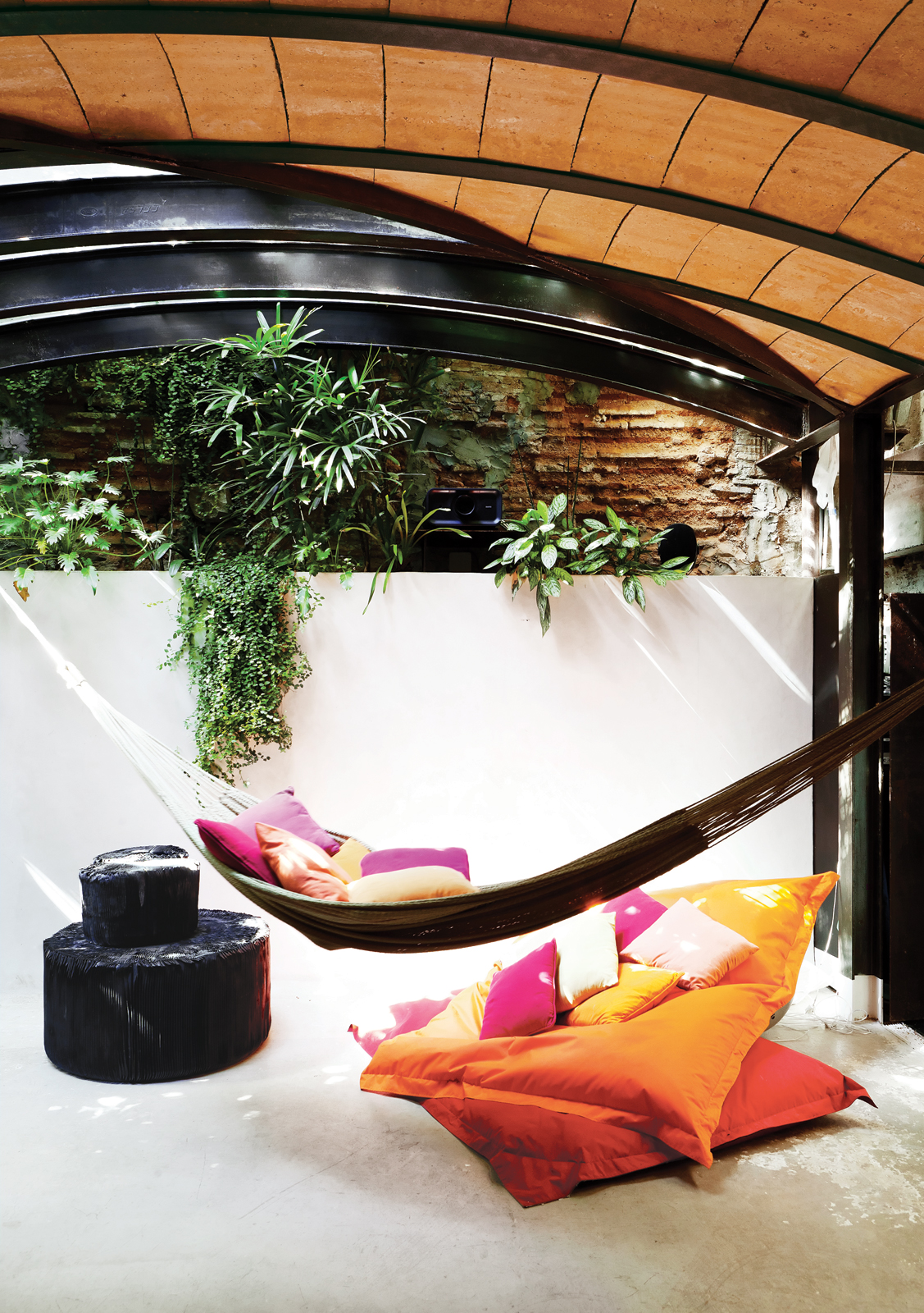 Outdoor area with hammock and barrel ceiling