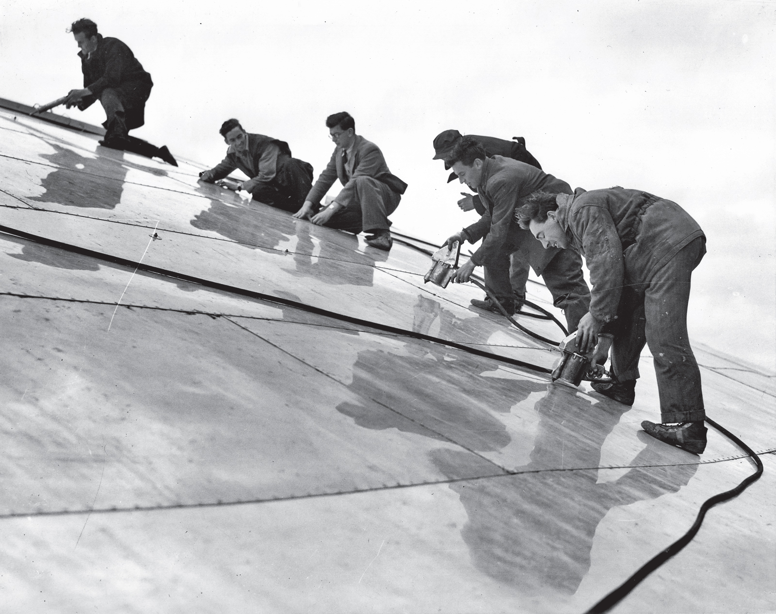 Workmen working on Dome of Discovery
