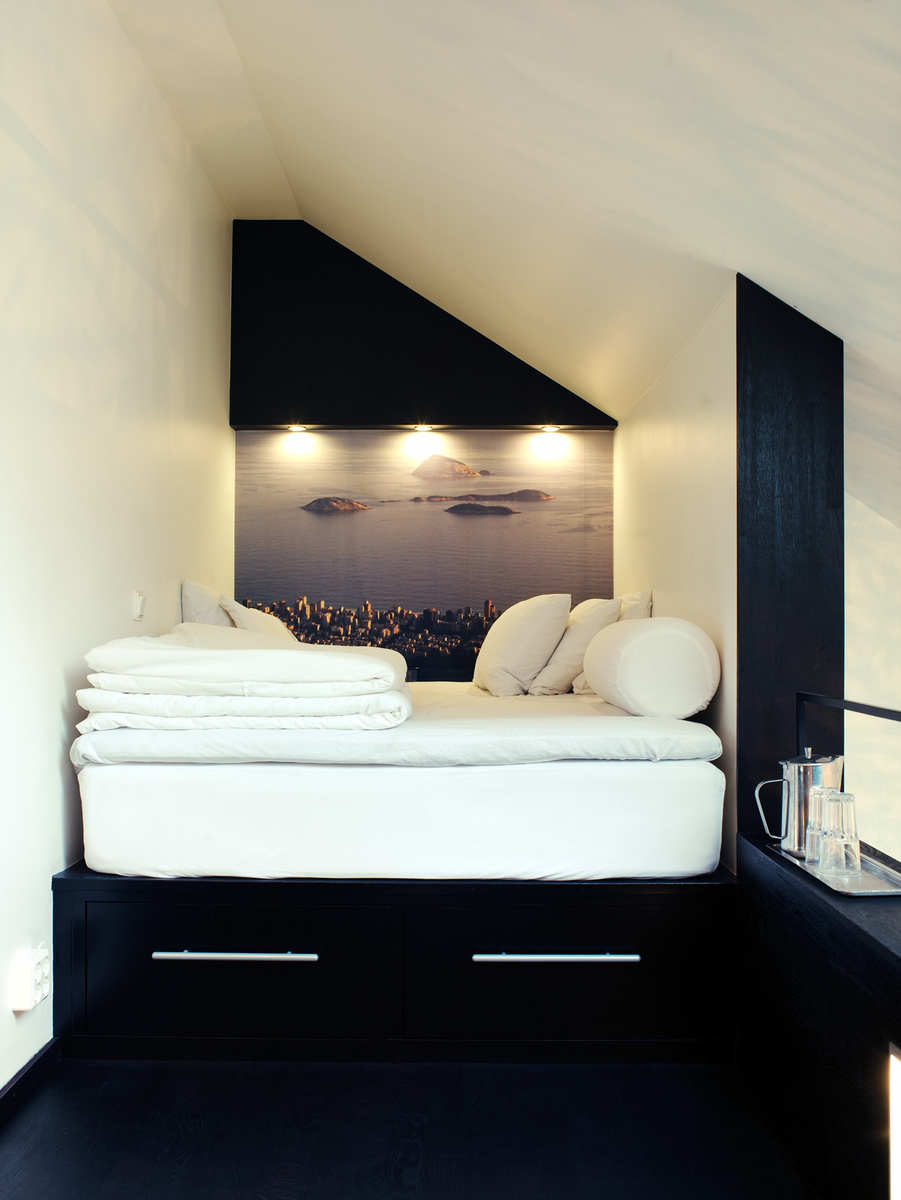 Modern sleeping loft with drawers and platform bed