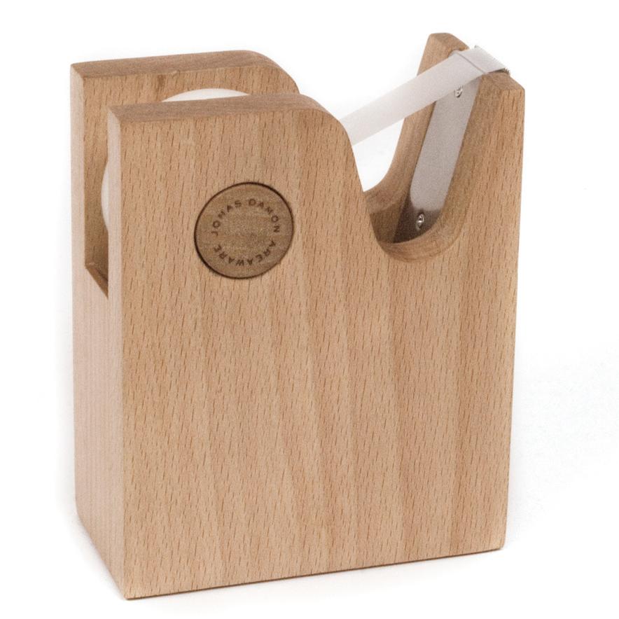 Wooden tape dispenser by Jonas Damon.