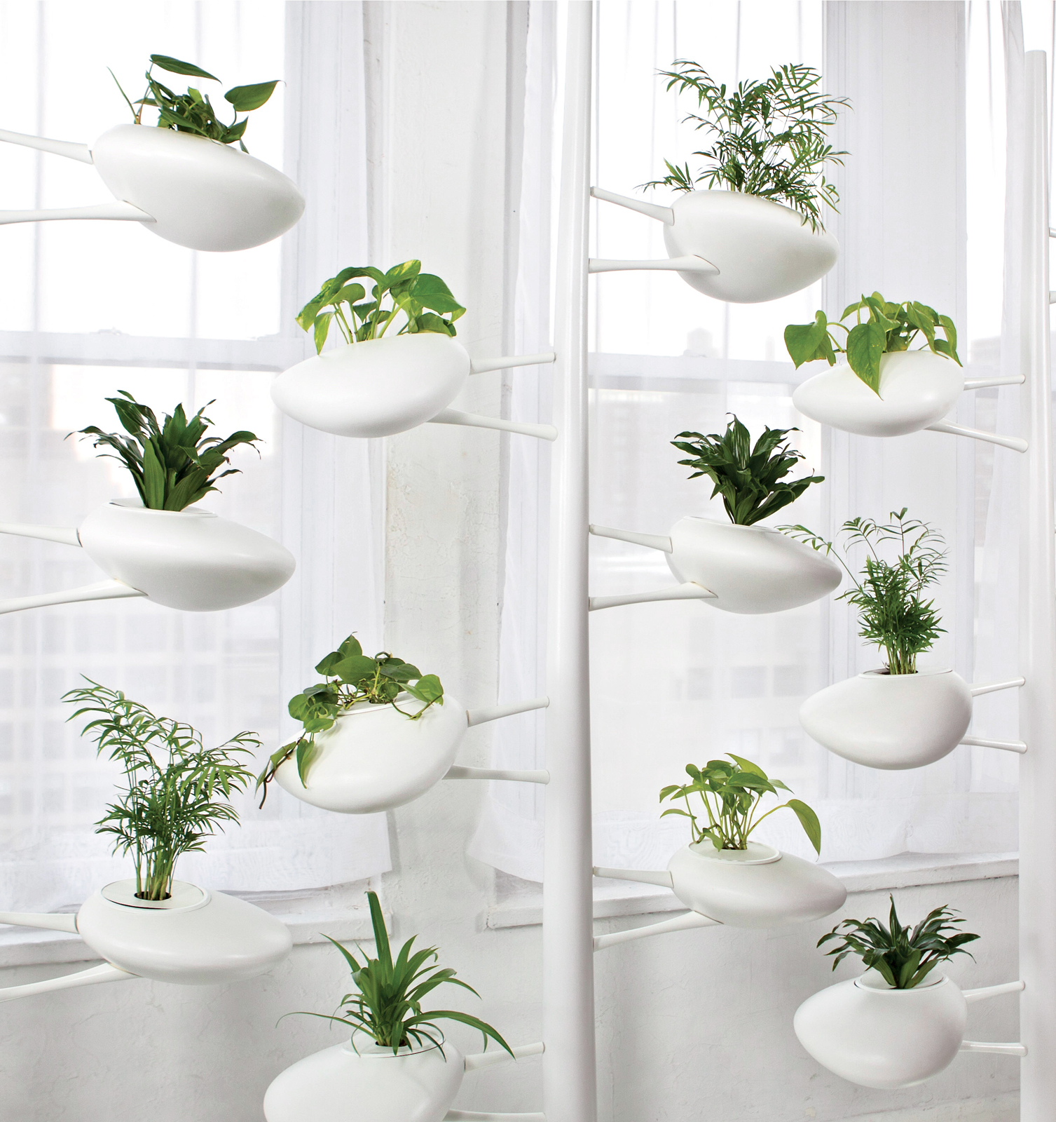 White self-sustaining indoor planter.