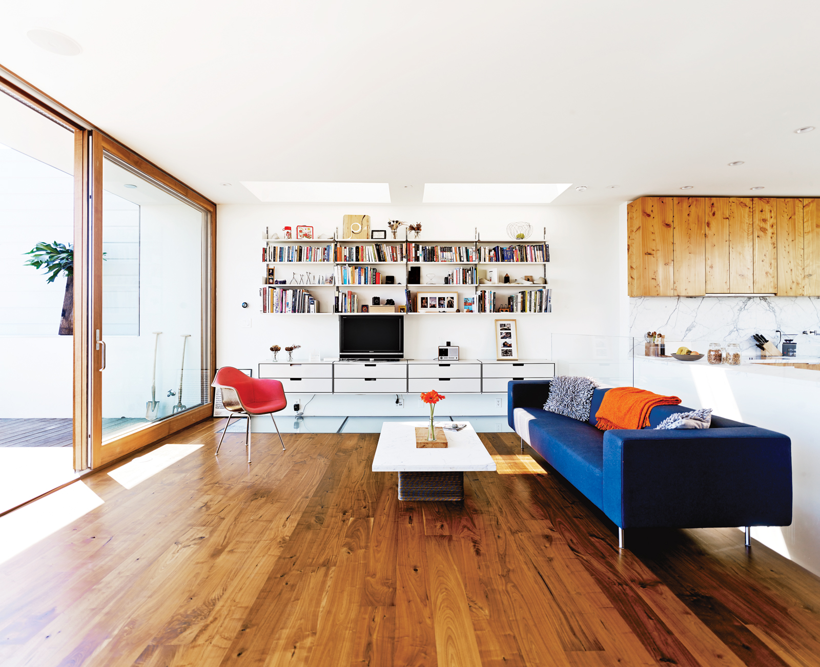 Modern living room with wooden floors and natural lighting