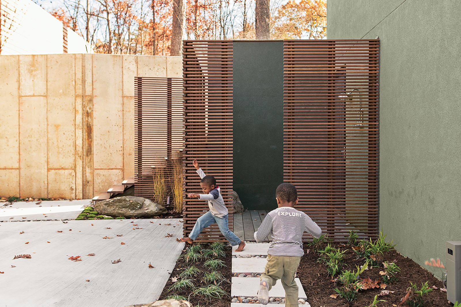 modern courtyard ipe wood slats concrete pavers