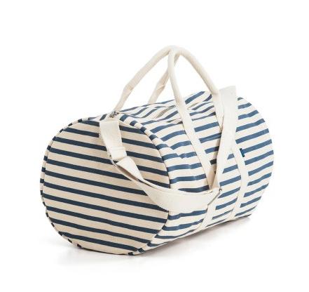 a striped canvas duffel bag