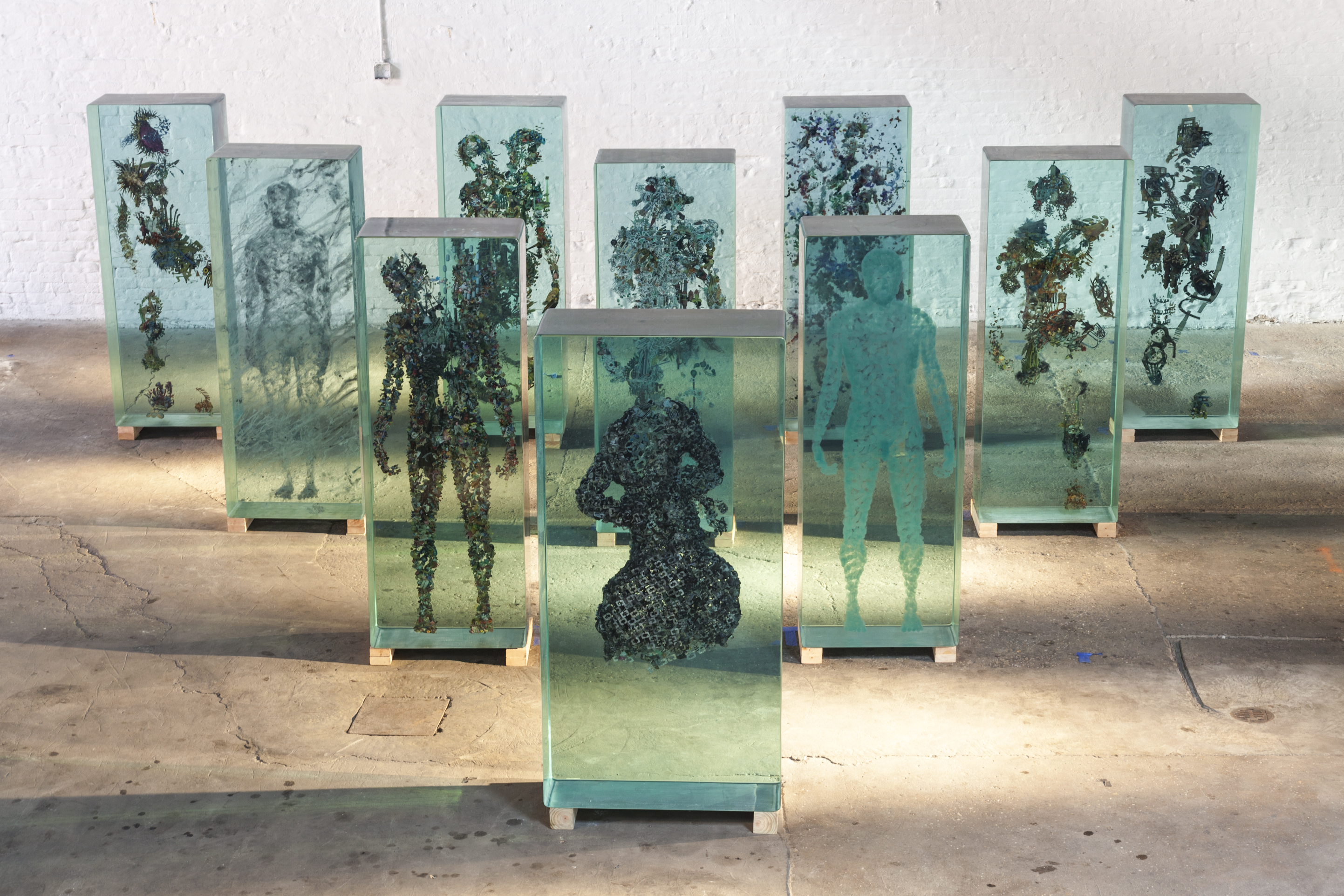Dustin Yellin glass sculptures magazines studio