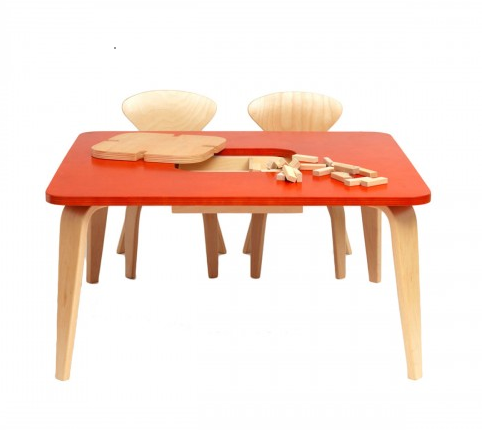 a small wood table with storage space for children