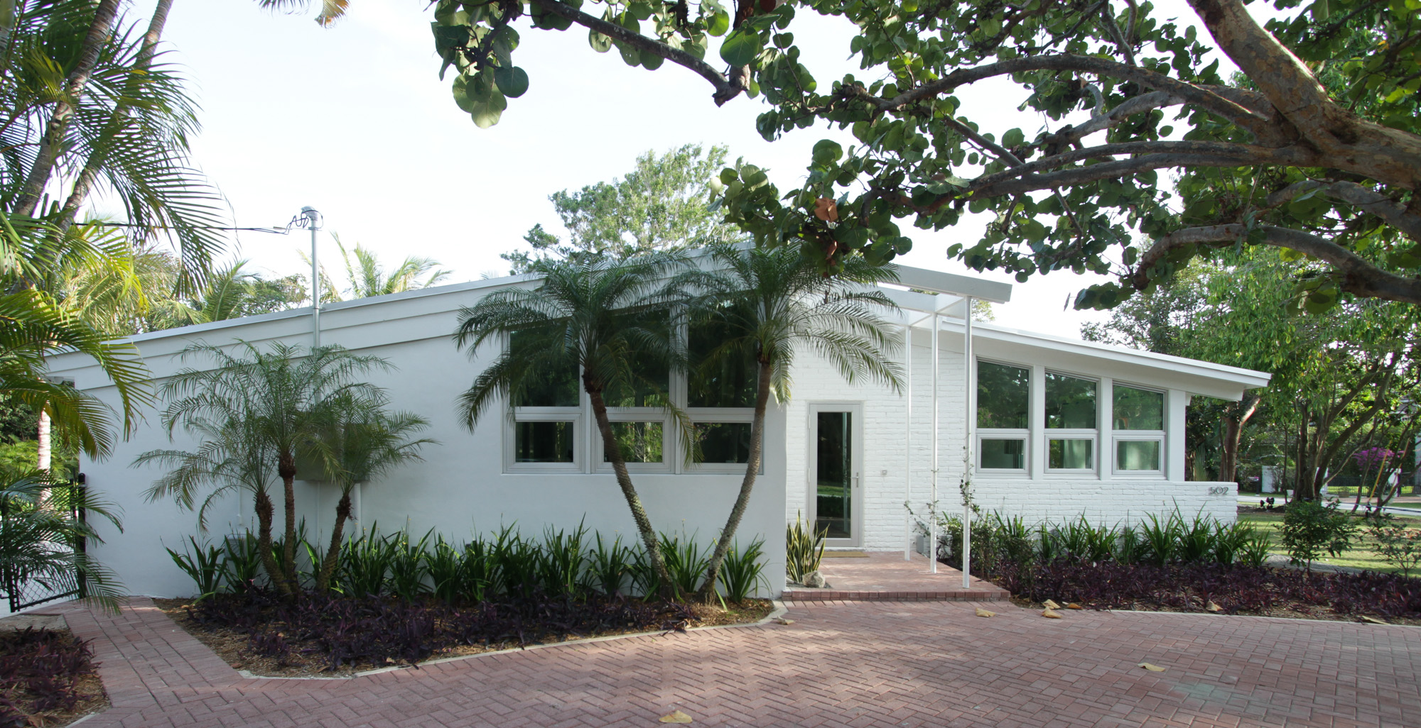 palm beach renovation all white exterior