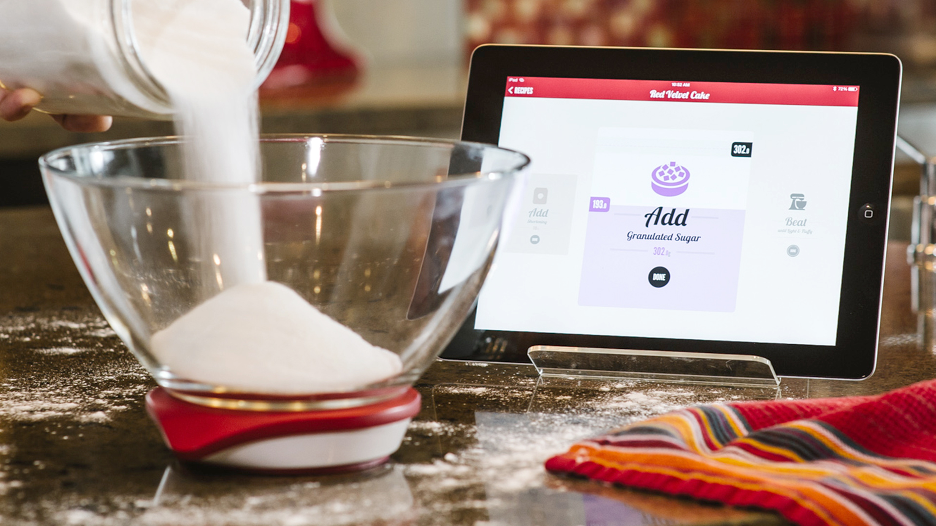 Drop kitchen scale filled with flour and accompanying iPad app